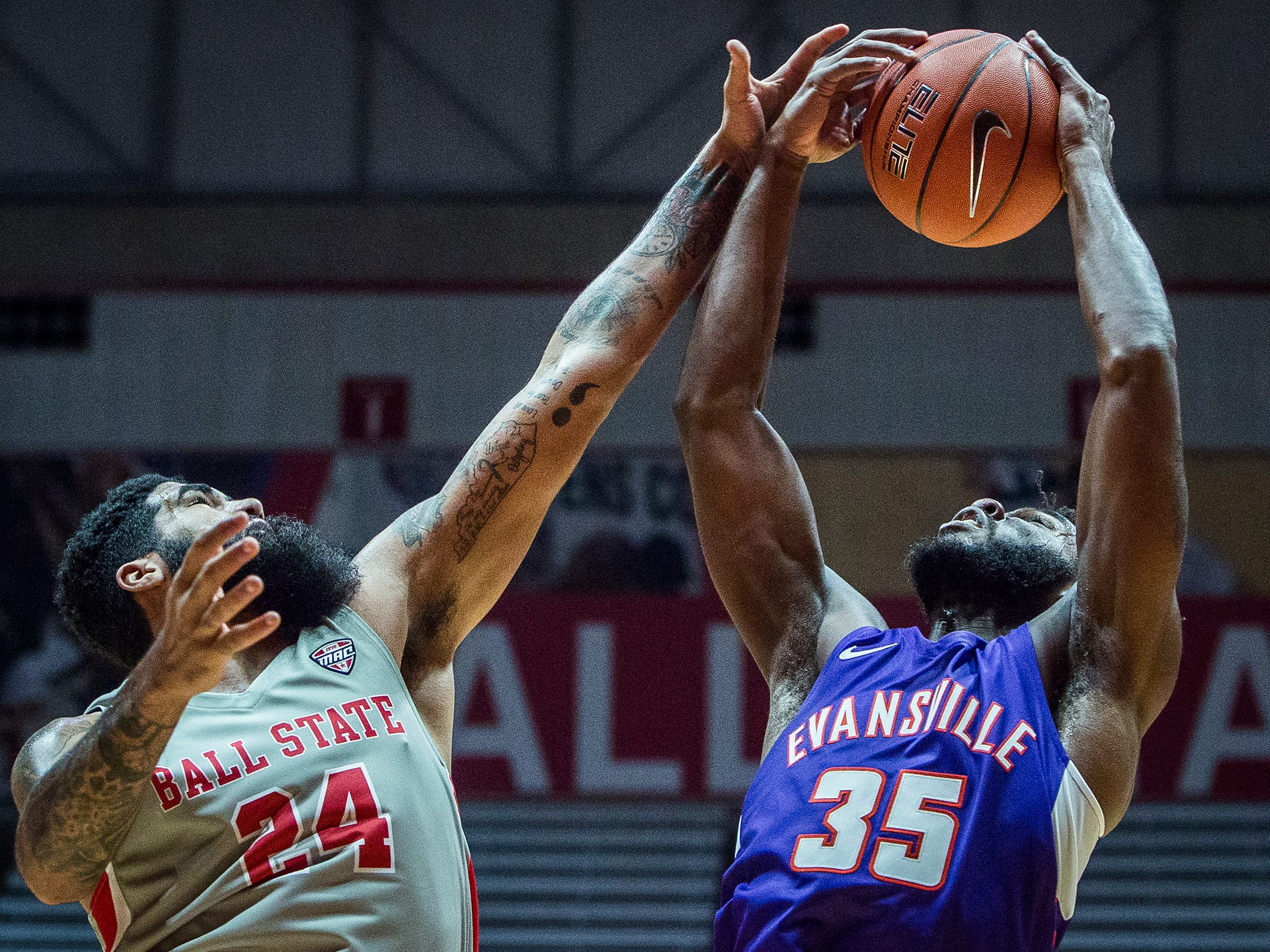 Evansville's John Hall goes up for a shot with Ball State's Trey Moses defending during their game at Worthen Arena Saturday, Nov. 24, 2018.