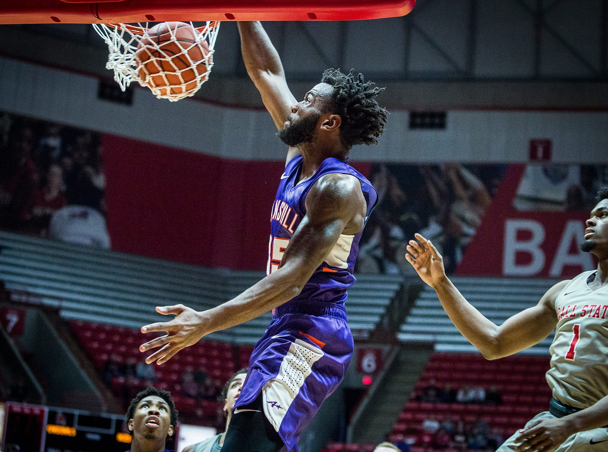 Evansville's John Hall dunks against Ball State's defense during their game at Worthen Arena Saturday, Nov. 24, 2018.