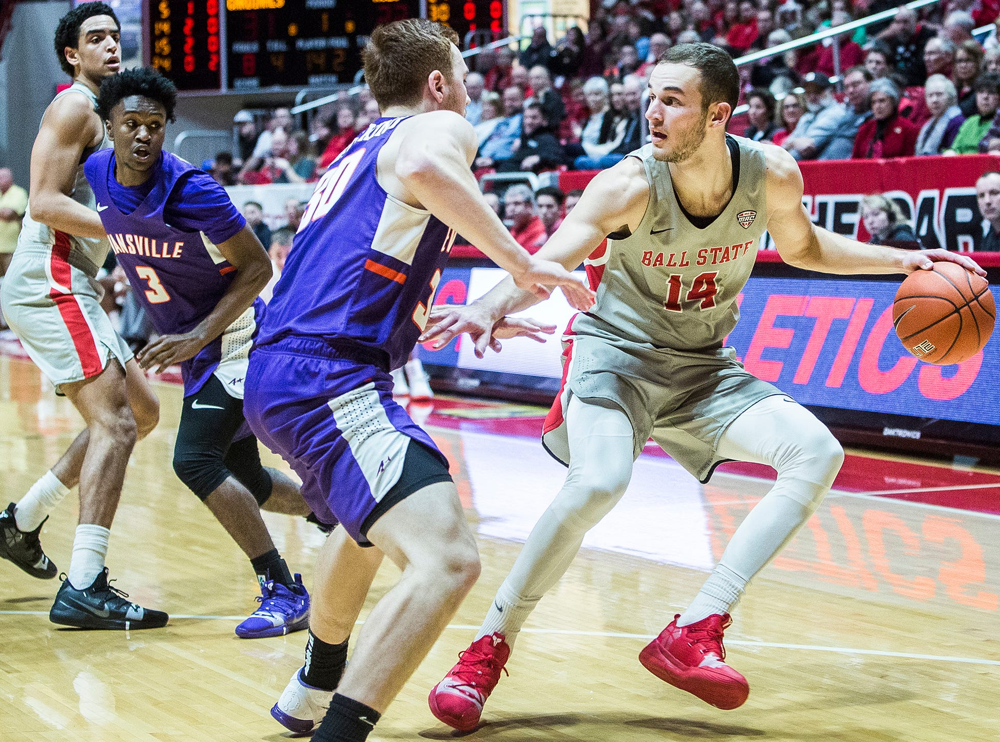 Ball State's Kyle Mallers looks for an opening in Evansville's defense during their game at Worthen Arena Saturday, Nov. 24, 2018.