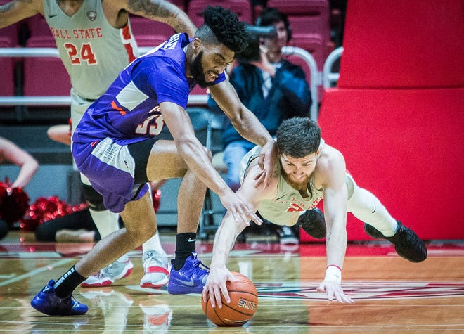 Ball State's Tayler Persons battles for possession against Evansville's John Hall during their game at Worthen Arena Saturday, Nov. 24, 2018.