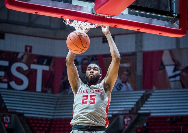 Ball State's Tahjai Teague dunks against Evansville's defense during their game at Worthen Arena Saturday, Nov. 24, 2018.