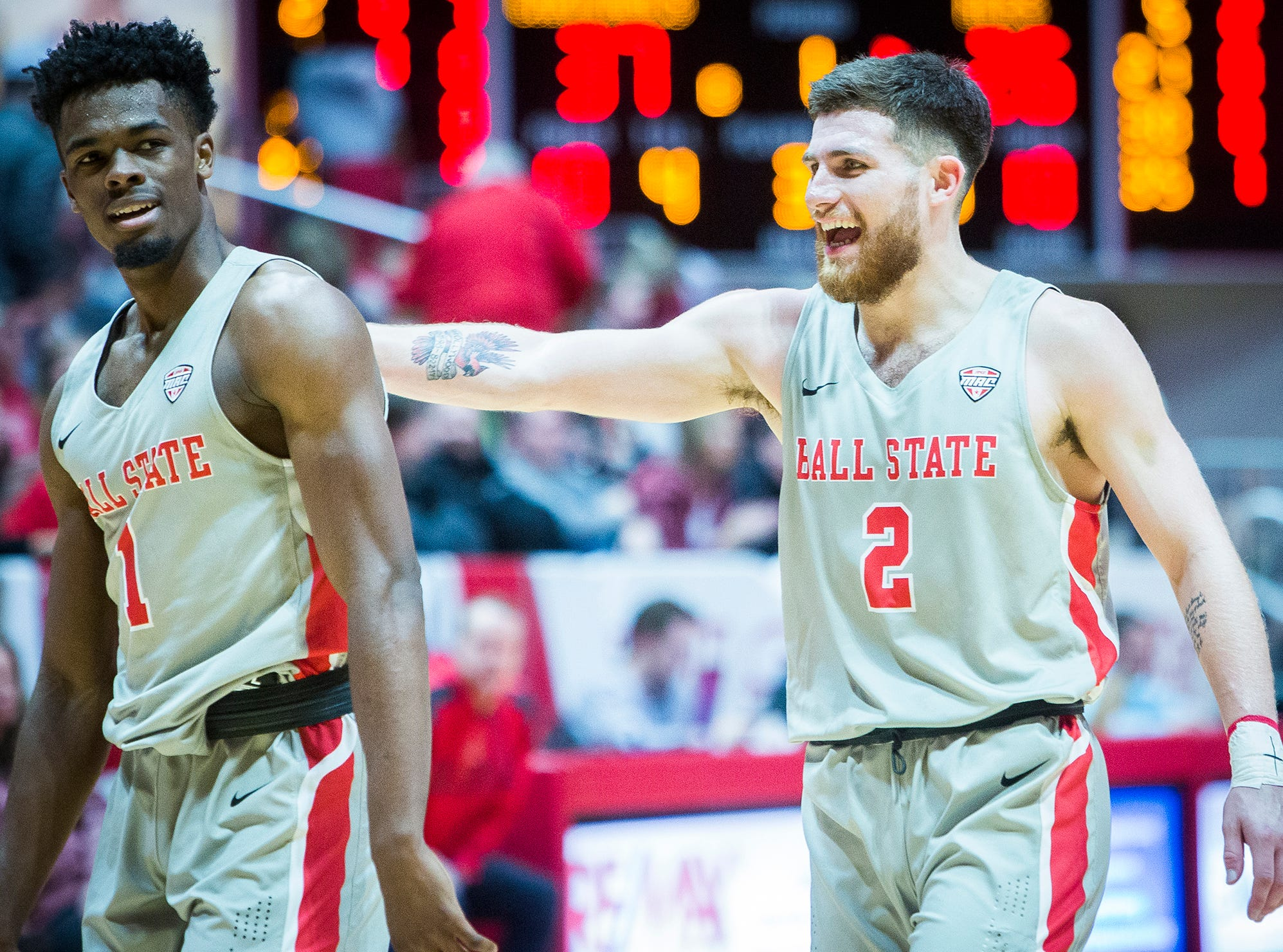 Ball State's Tayler Persons celebrates with K.J. Walton at the end of the first half during their game against Evansville at Worthen Arena Saturday, Nov. 24, 2018.
