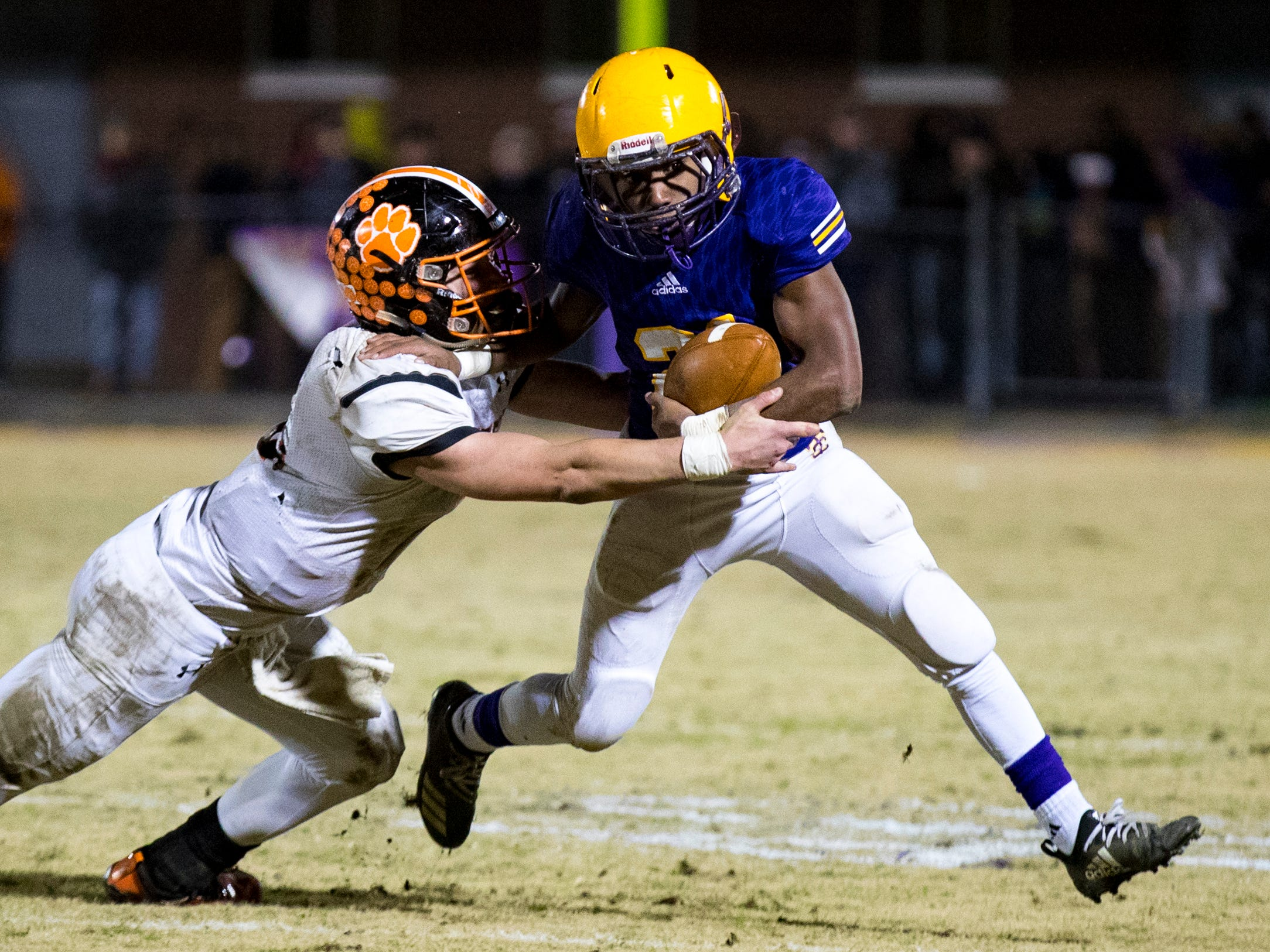 Trousdale County's Dyson Satterfield (21) sheds a tackle during Trousdale County's game against Meigs County at Jim Satterfield Stadium in Hartsville on Friday, Nov. 23, 2018.
