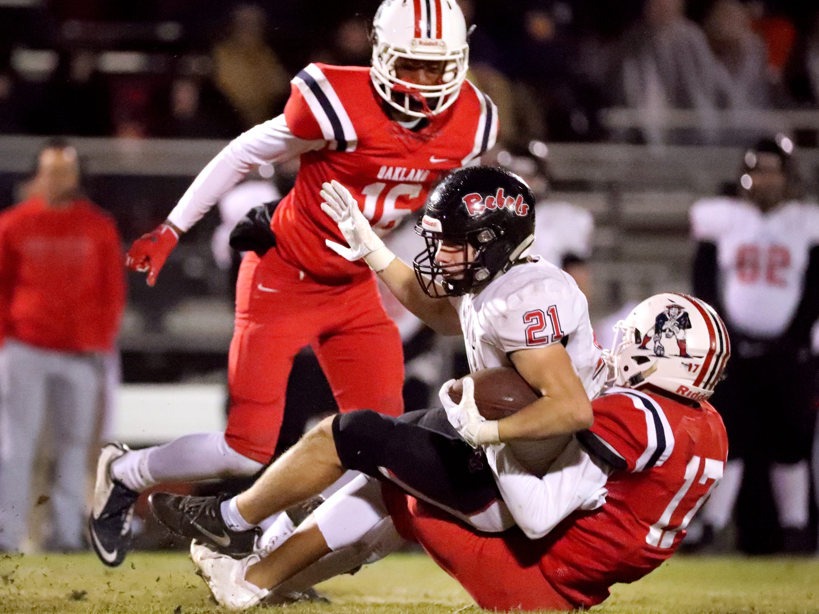 Maryville's Bryson Teffeteller (21) runs the ball as Oakland's Eddie Willis (17) takes him down at Oakland in Murfreesboro, on Friday, Nov. 23 2018, during the 6A playoffs.