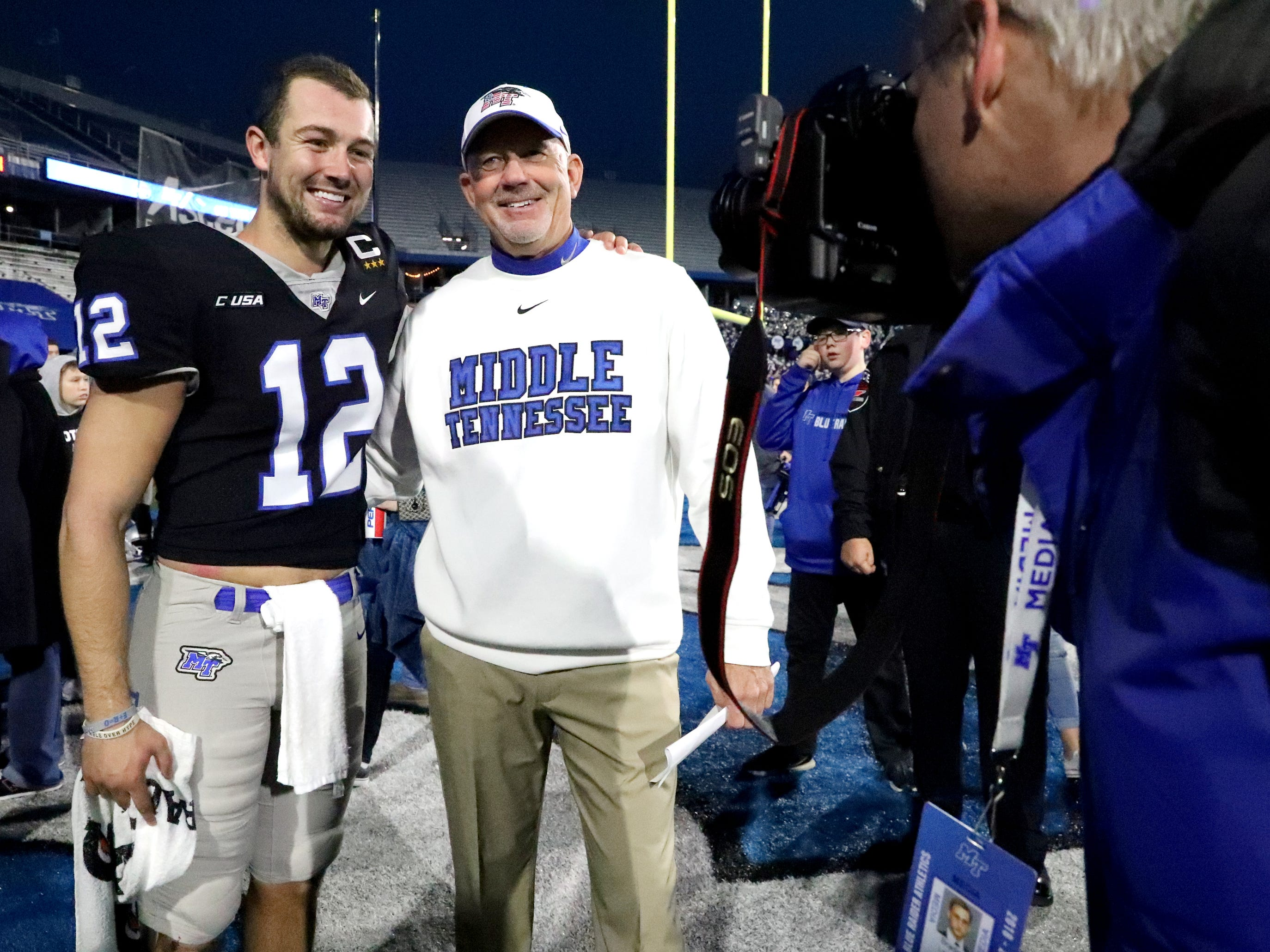 MTSU quarterback Brent Stockstill gets a picture taken with his dad head coach Rick Stockstill following MTSU's win over UAB and the announcement that MTSU is the 2018 C-USA East Division Champions and will host the Conference USA Championship next week.