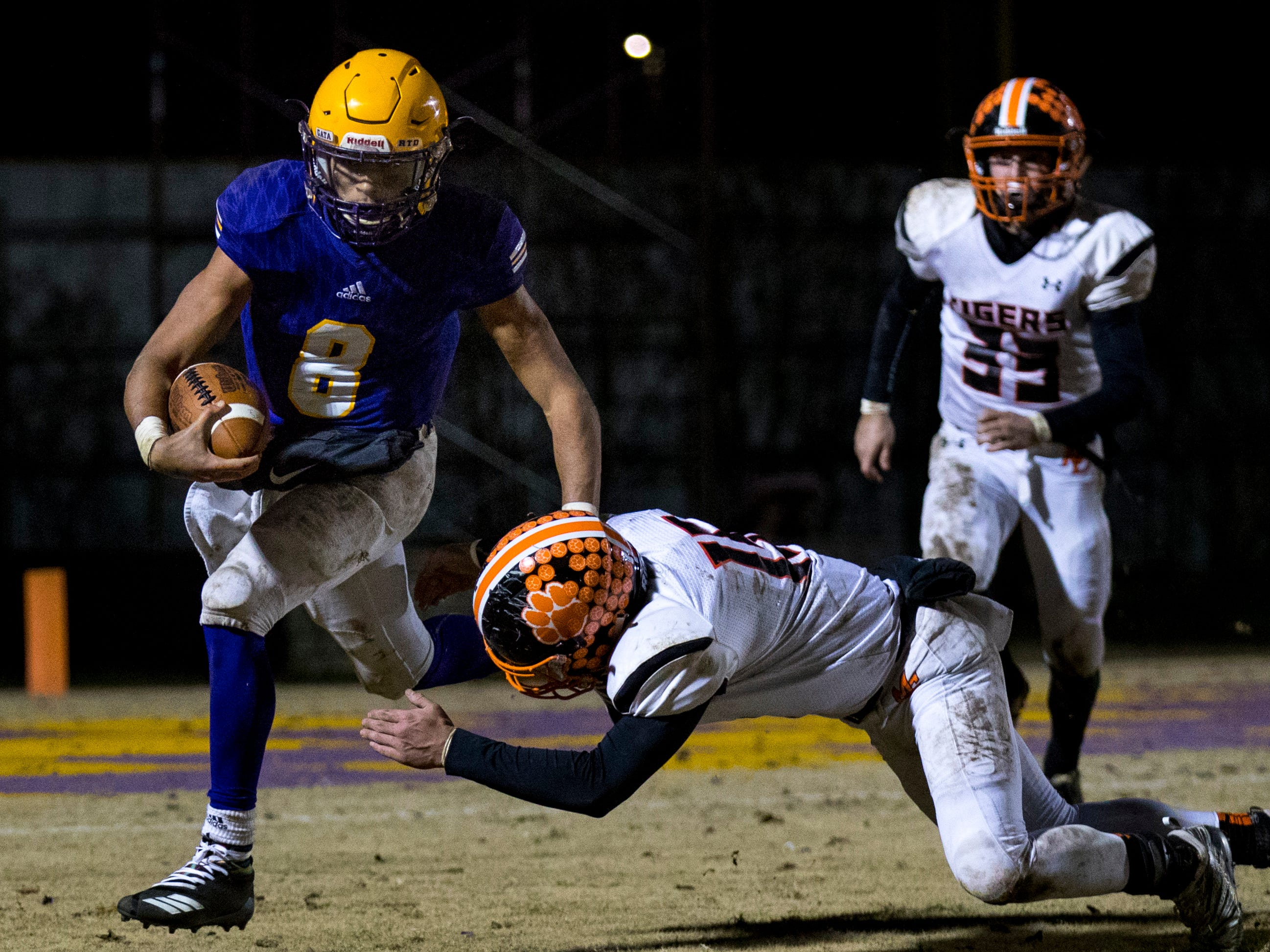 Trousdale County's Keyvont Baines (8) dodges a tackle during Trousdale County's game against Meigs County at Jim Satterfield Stadium in Hartsville on Friday, Nov. 23, 2018.