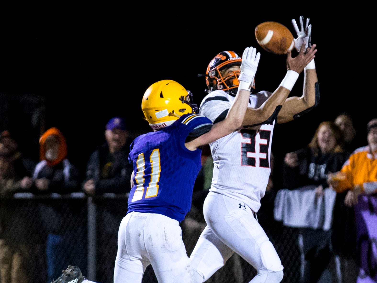 Meigs County's Jon Jon Beeler (23) tries to catch a pass but it is broken up by Trousdale County's Ben Chumley (11) during Trousdale County's game against Meigs County at Jim Satterfield Stadium in Hartsville on Friday, Nov. 23, 2018.