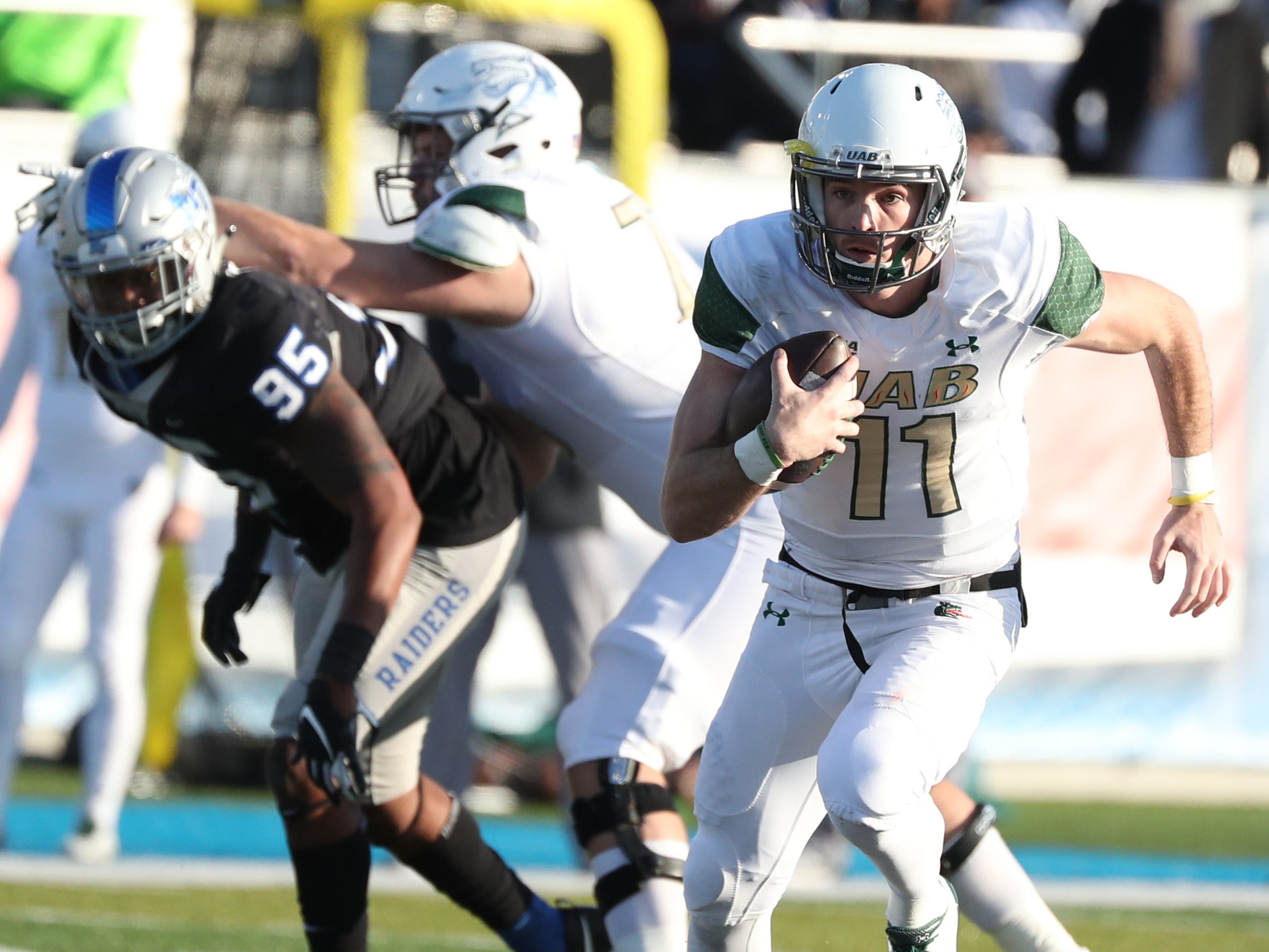 UAB's quarterback AJ Erdely (11) runs the option against MTSU during the game at MTSU on Saturday, Nov. 24, 2018.