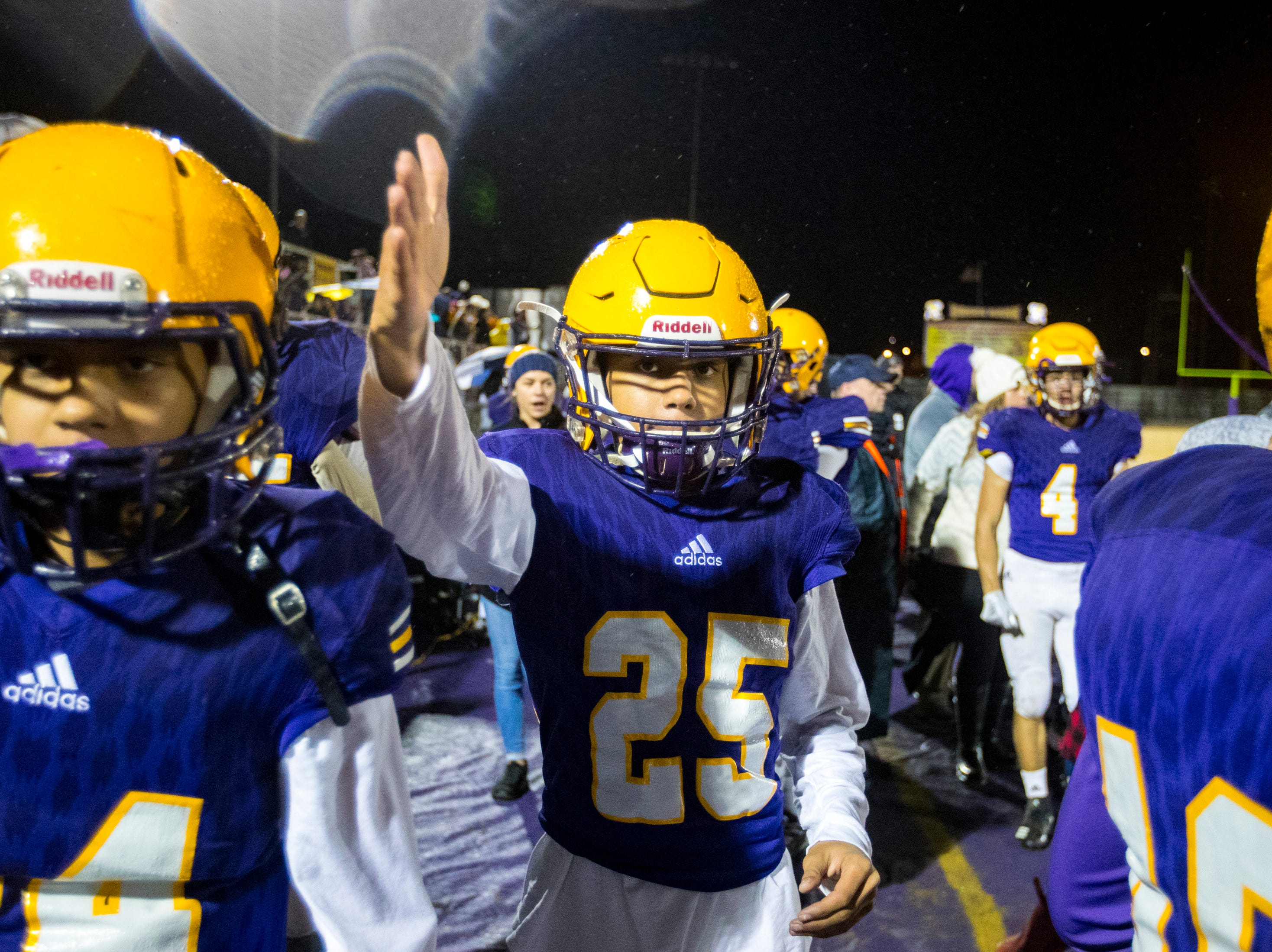 Trousdale County's Kane Burnley (25) motions for a first down during Trousdale County's game against Meigs County at Jim Satterfield Stadium in Hartsville on Friday, Nov. 23, 2018.