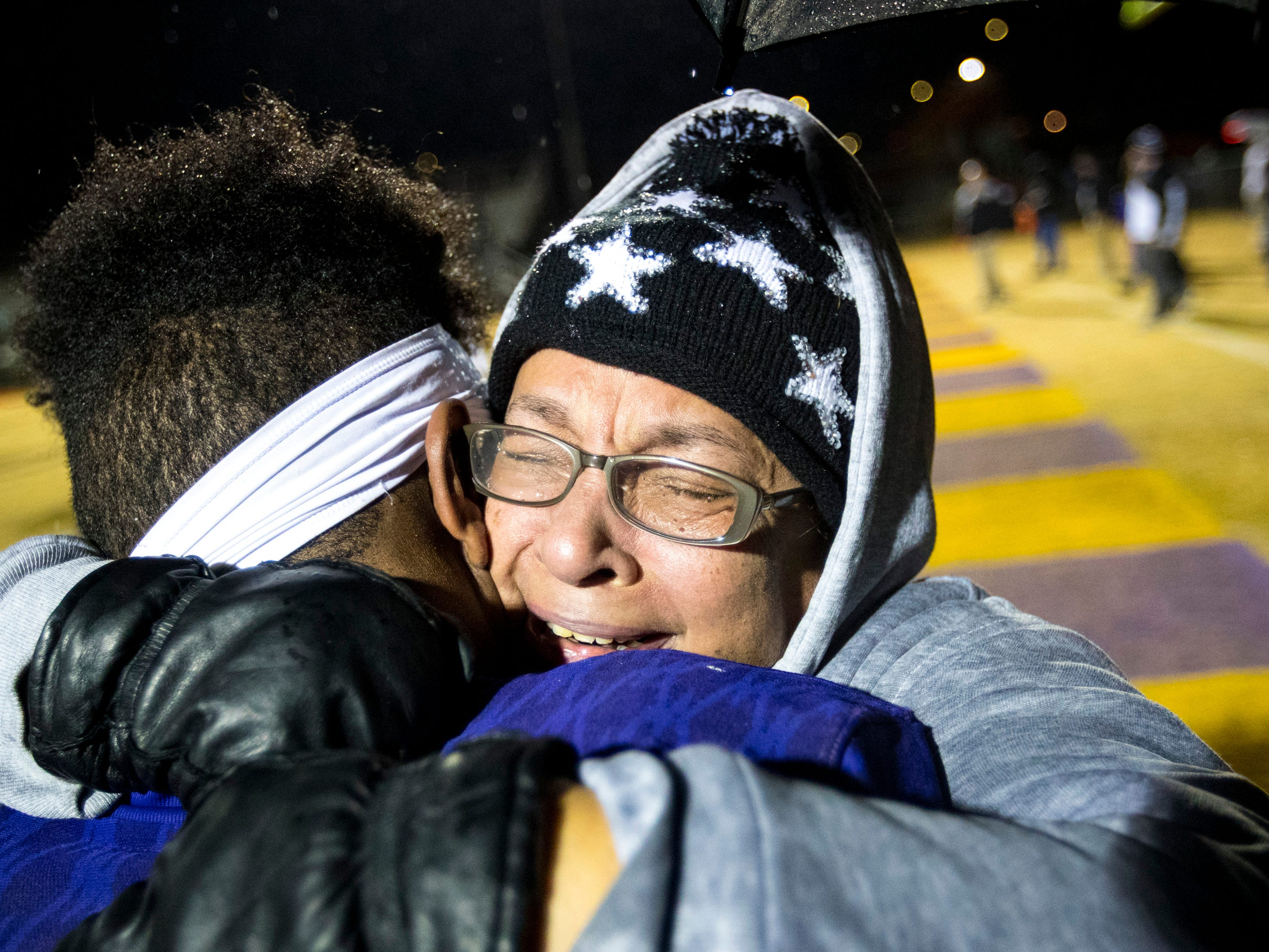 Elaine Walton hugs her grandson Trousdale County's Dyson Satterfield (21) after Trousdale County's game against Meigs County at Jim Satterfield Stadium in Hartsville on Friday, Nov. 23, 2018.