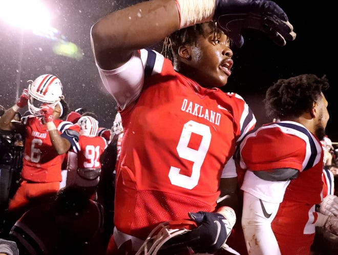 Oakland's Tekoy Randolph (9) celebrates beating Maryville 38-0 at Oakland in Murfreesboro, on Friday, Aug. 23 2018, during the 6A playoffs and advancing to the State Tournament next week.