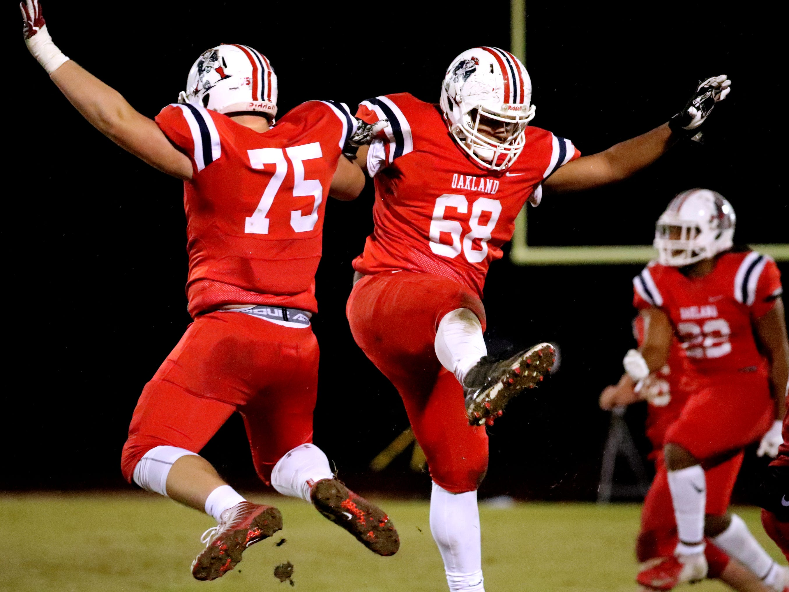 Oakland's Kain Williams (75) and Jalyn Willard (68) celebrate a fumble recovery by Oakland's Malik Sibert (11) during the game against Maryville at Oakland in Murfreesboro, on Friday, Aug. 23 2018, during the 6A playoffs.