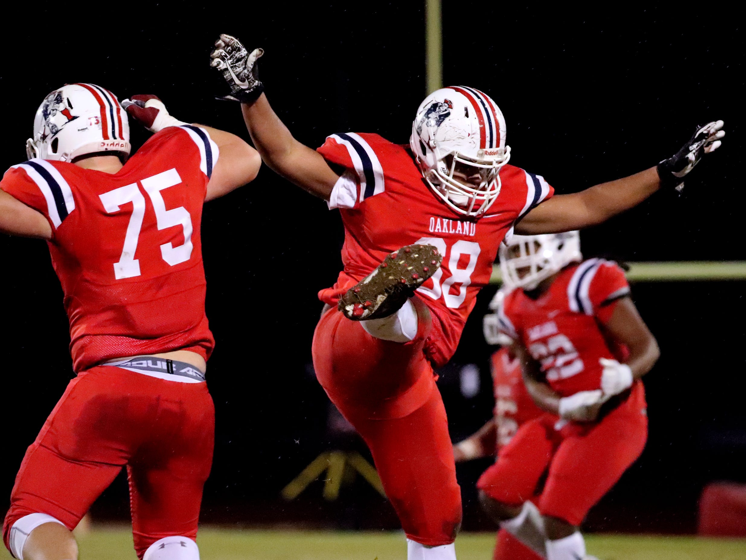 Oakland's Kain Williams (75) and Jalyn Willard (68) celebrate a fumble recovery by Malik Sibert (11) during the game against Maryville at Oakland in Murfreesboro, on Friday, Nov. 23 2018, during the 6A playoffs.