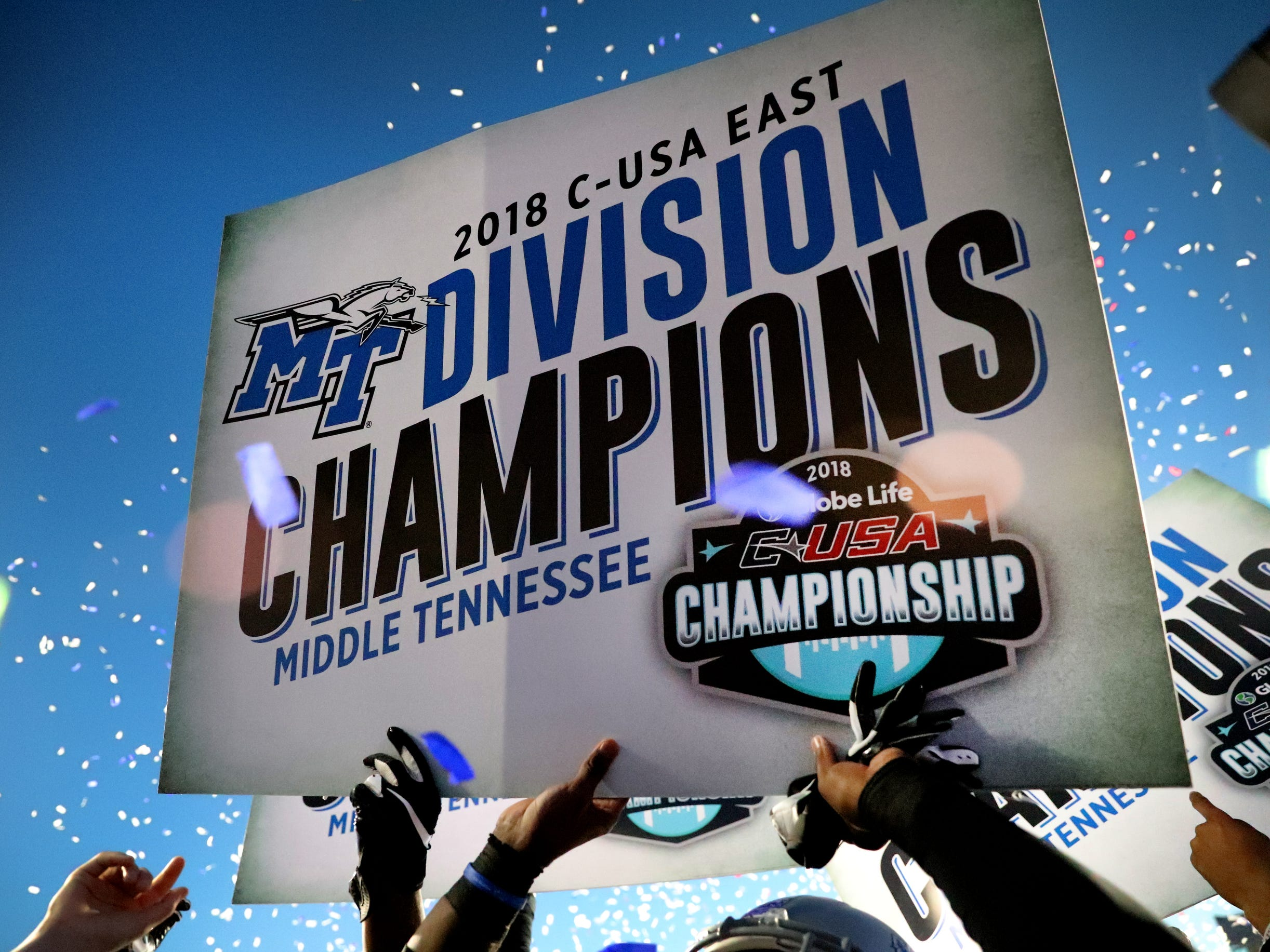 MTSU players celebrate their East Division championship after beating UAB on Saturday, Nov. 24, 2018.