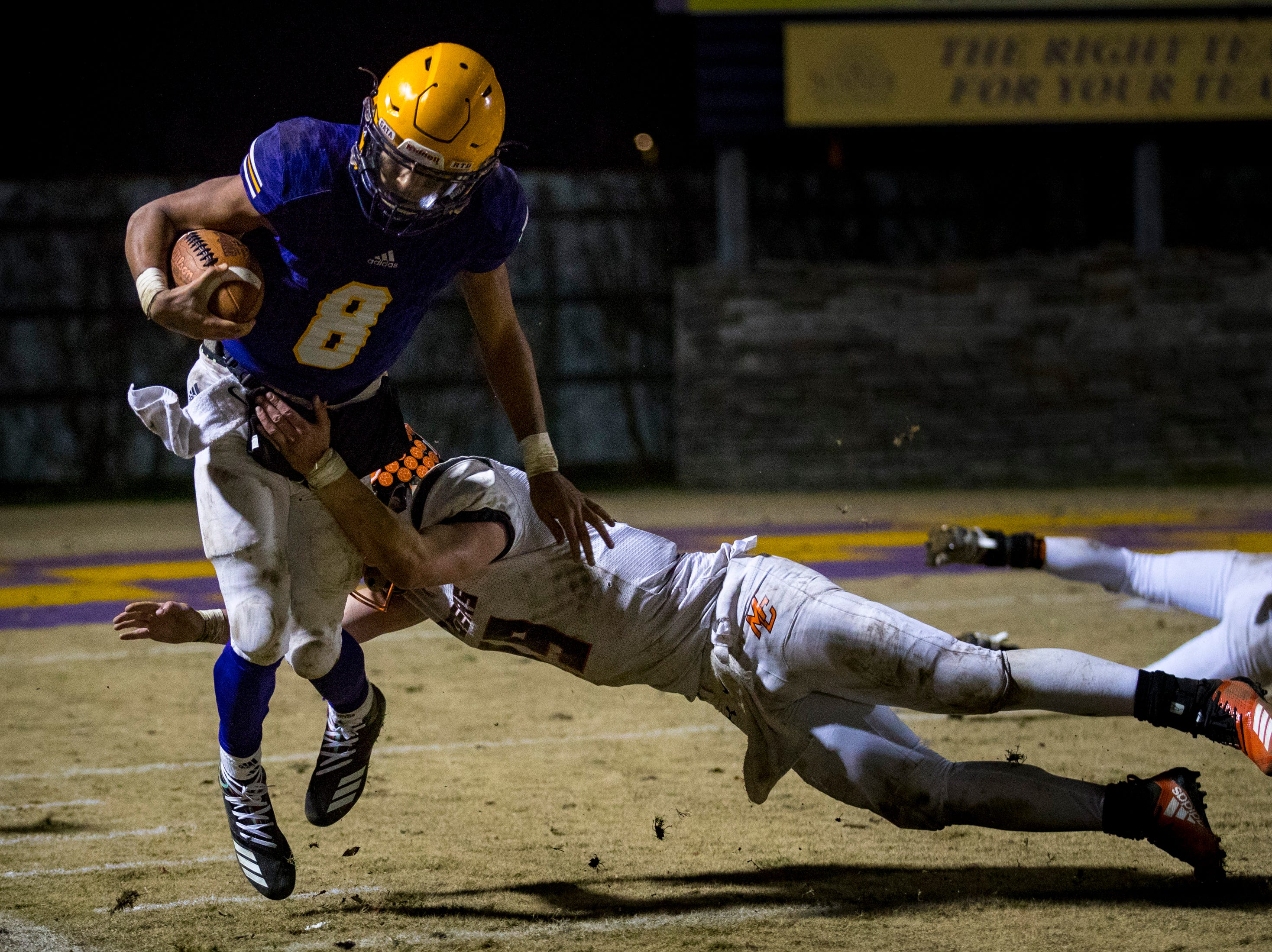 Trousdale County's Keyvont Baines (8) tries to dodge a tackle during Trousdale County's game against Meigs County at Jim Satterfield Stadium in Hartsville on Friday, Nov. 23, 2018.