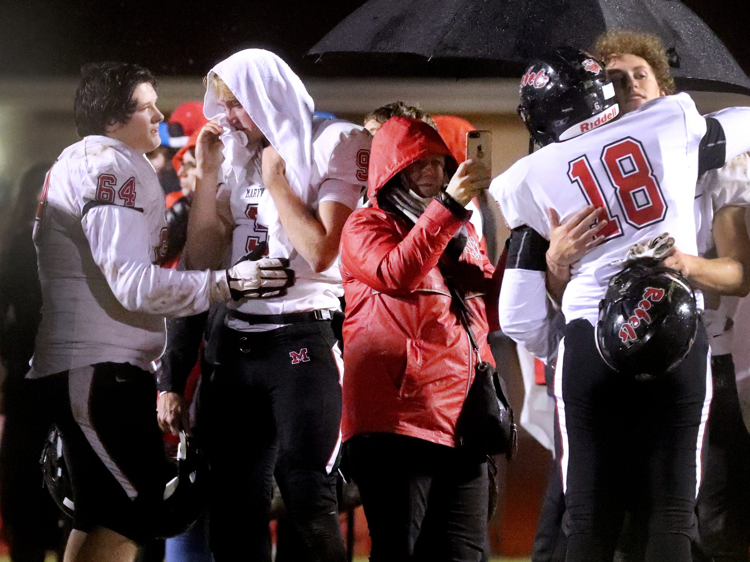 Maryville's players Blaize Welch (64) and quarterback Cade Chambers (9) console each other as well as Carson Jones (18) and Michael Jones (6) after losing to Oakland 38-0 in Murfreesboro, on Friday, Aug. 23 2018, during the 6A playoffs.