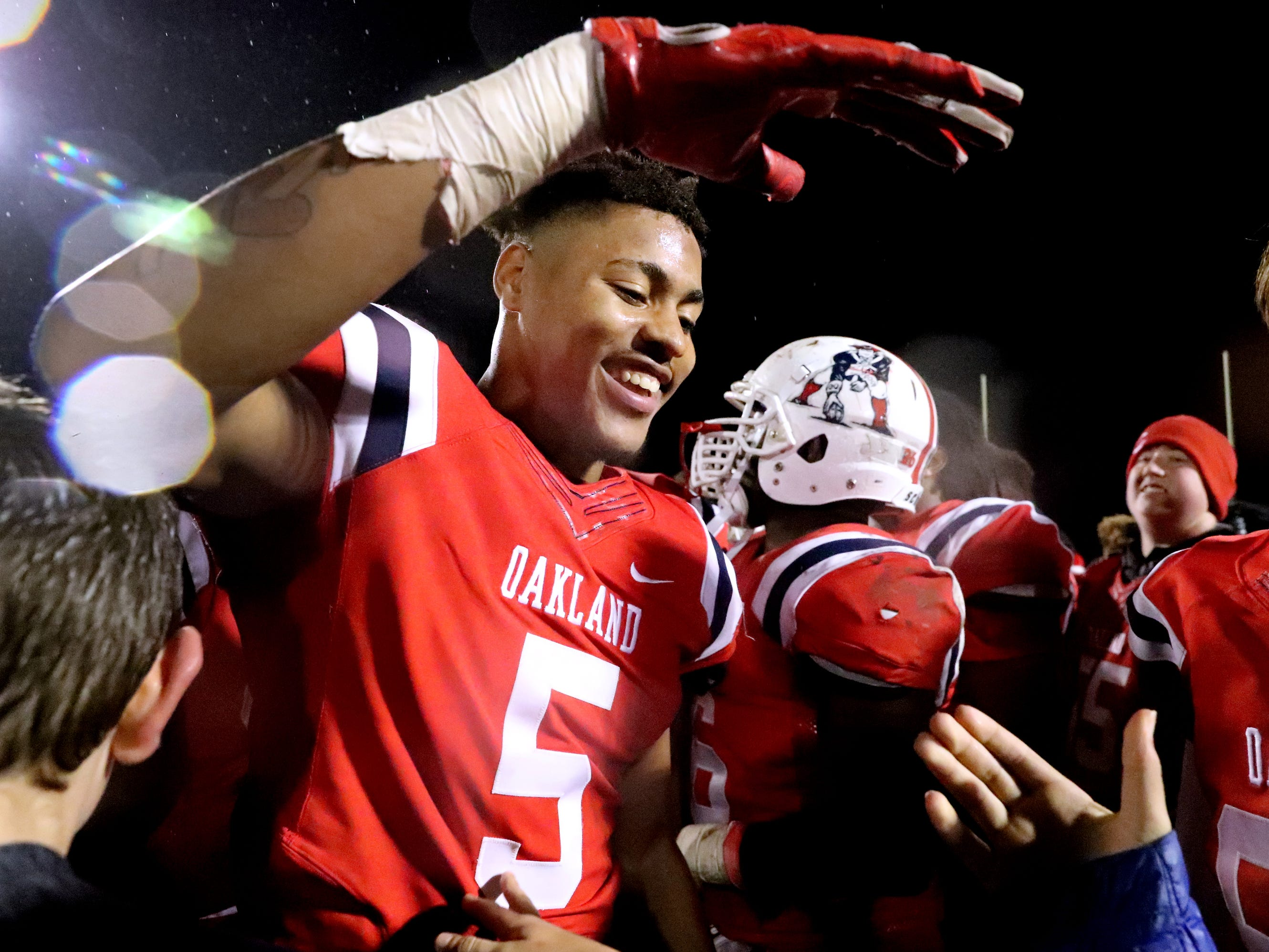 Oakland's Woodi Washington (5) celebrates beating Maryville 38-0 at Oakland in Murfreesboro, on Friday, Aug. 23 2018, during the 6A playoffs and advancing to the State Tournament next week.