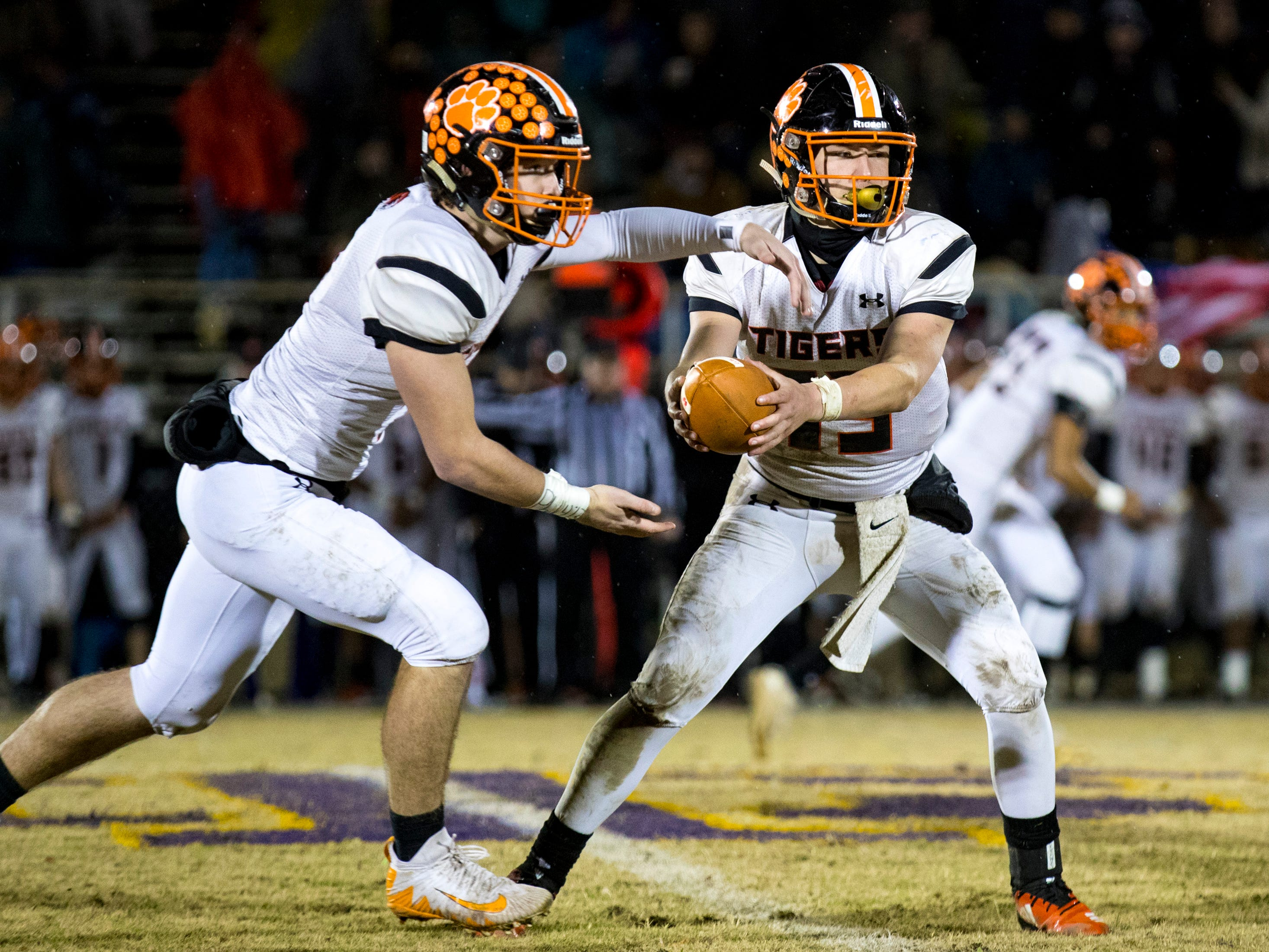 Meigs County's Aaron Swafford (19) fakes a handoff during Trousdale County's game against Meigs County at Jim Satterfield Stadium in Hartsville on Friday, Nov. 23, 2018.