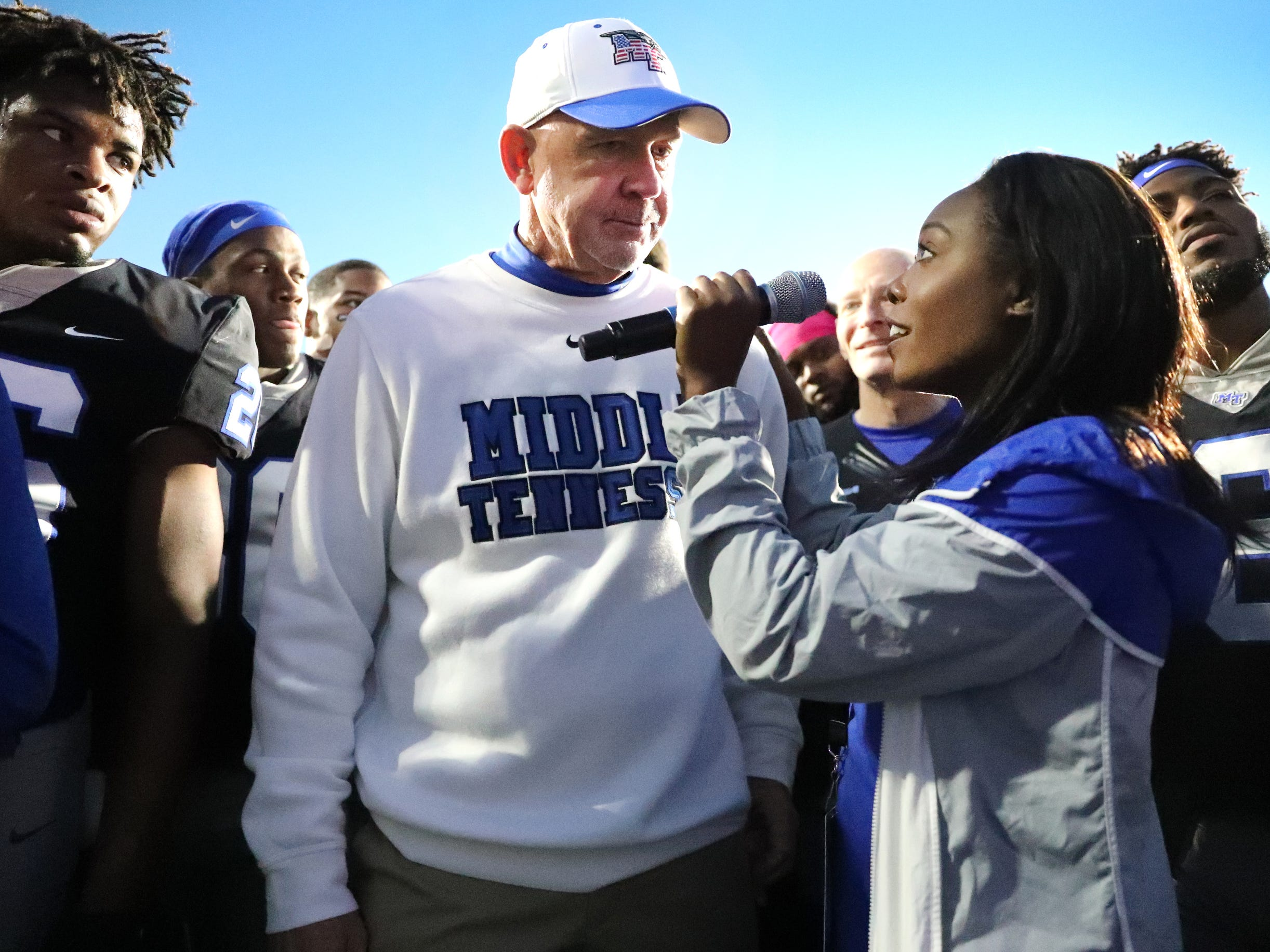 MTSU's head coach Rick Stockstill is interviewed by Chelsea Floyd, with MTSU marketing, after MTSU's win over UAB and the announcement that MTSU is the 2018 C-USA East Division Champions and will host the Conference USA Championship next week.