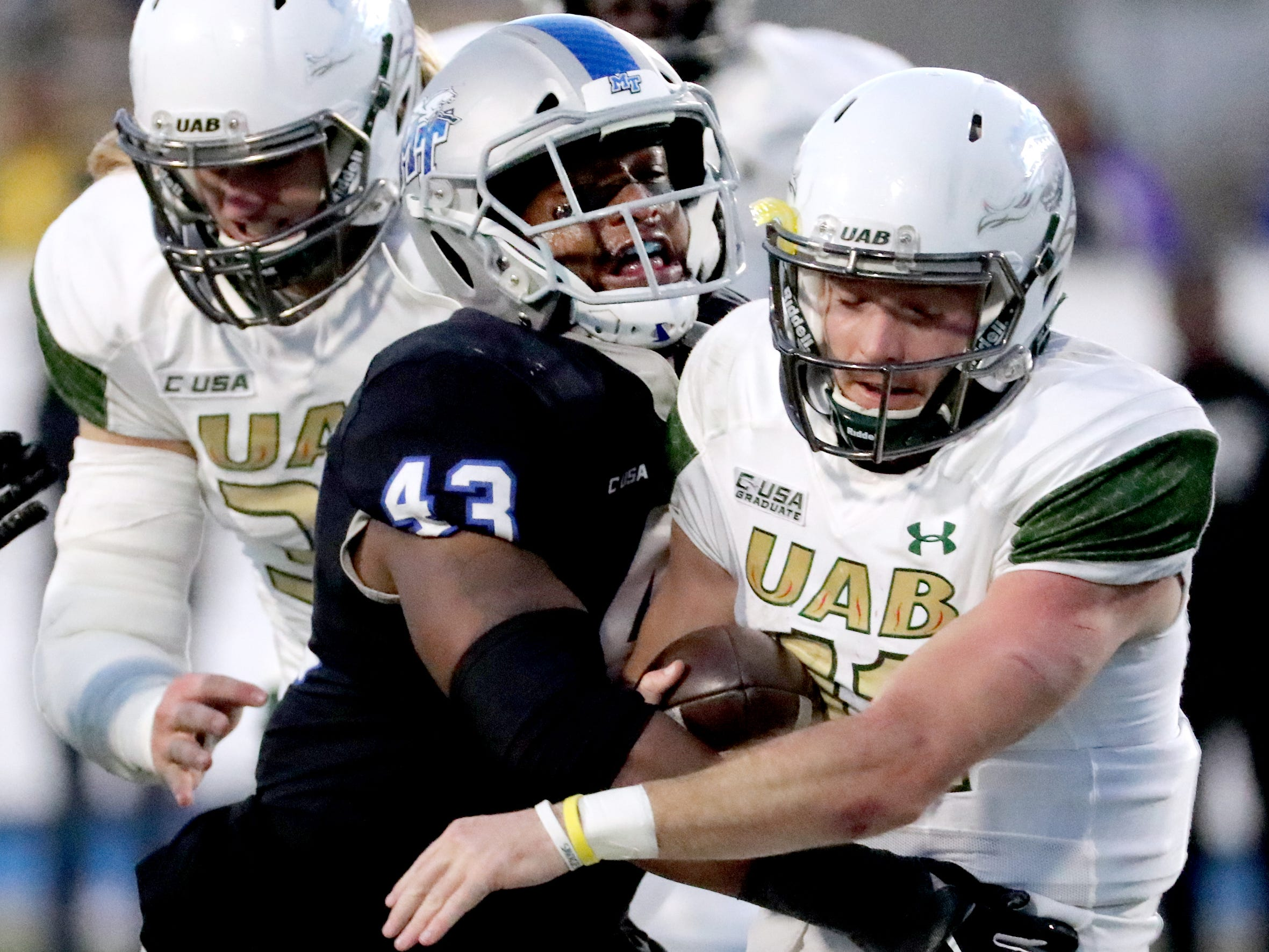 MTSU's Jahmal Jones (43) sacks UAB's quarterback AJ Erdely (11) during the game at MTSU on Saturday, Nov. 24, 2018.