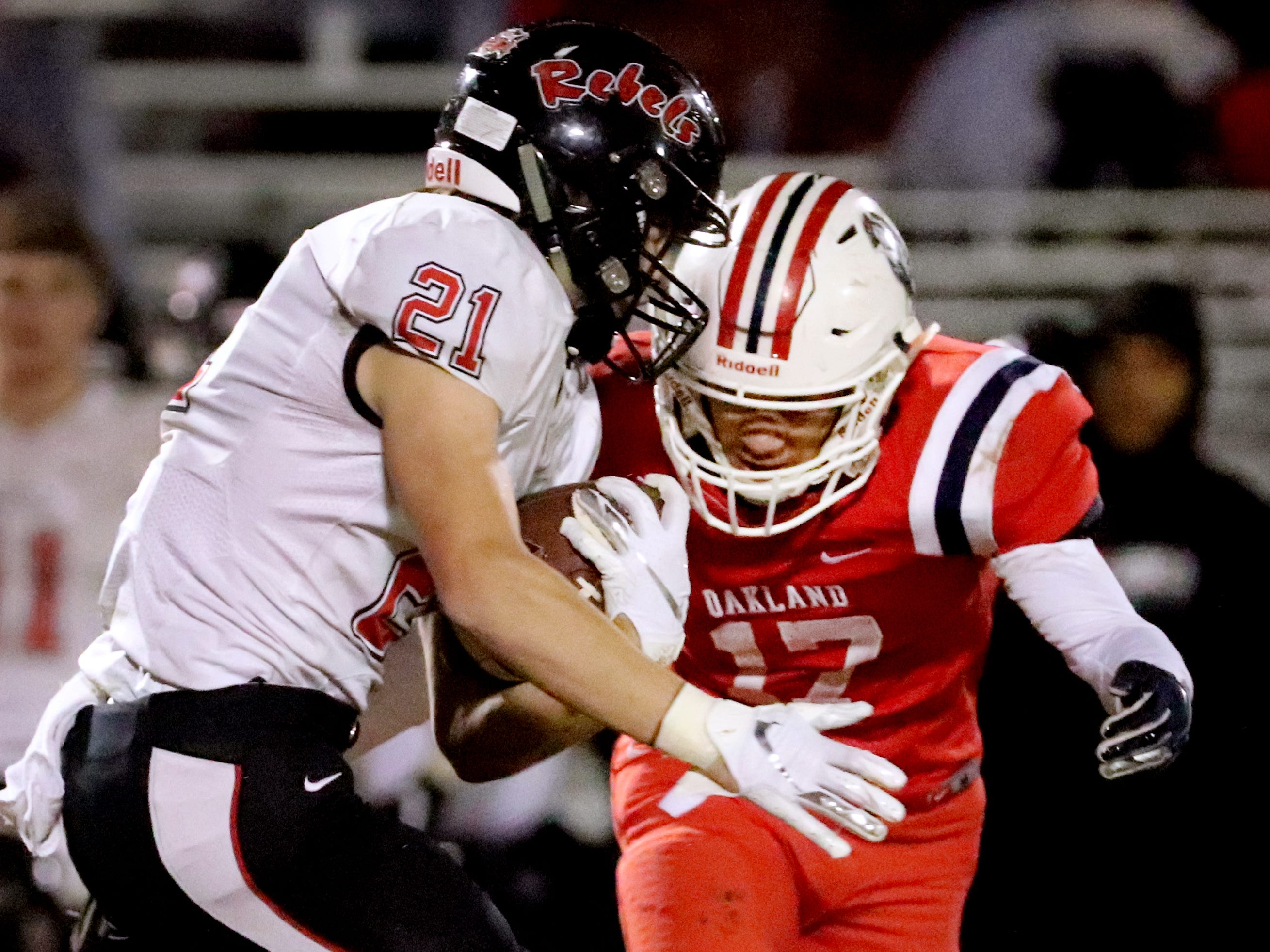 Maryville's Bryson Teffeteller (21) runs the ball as Oakland's Eddie Willis (17) moves in for the tackle at Oakland in Murfreesboro, on Friday, Aug. 23 2018, during the 6A playoffs.