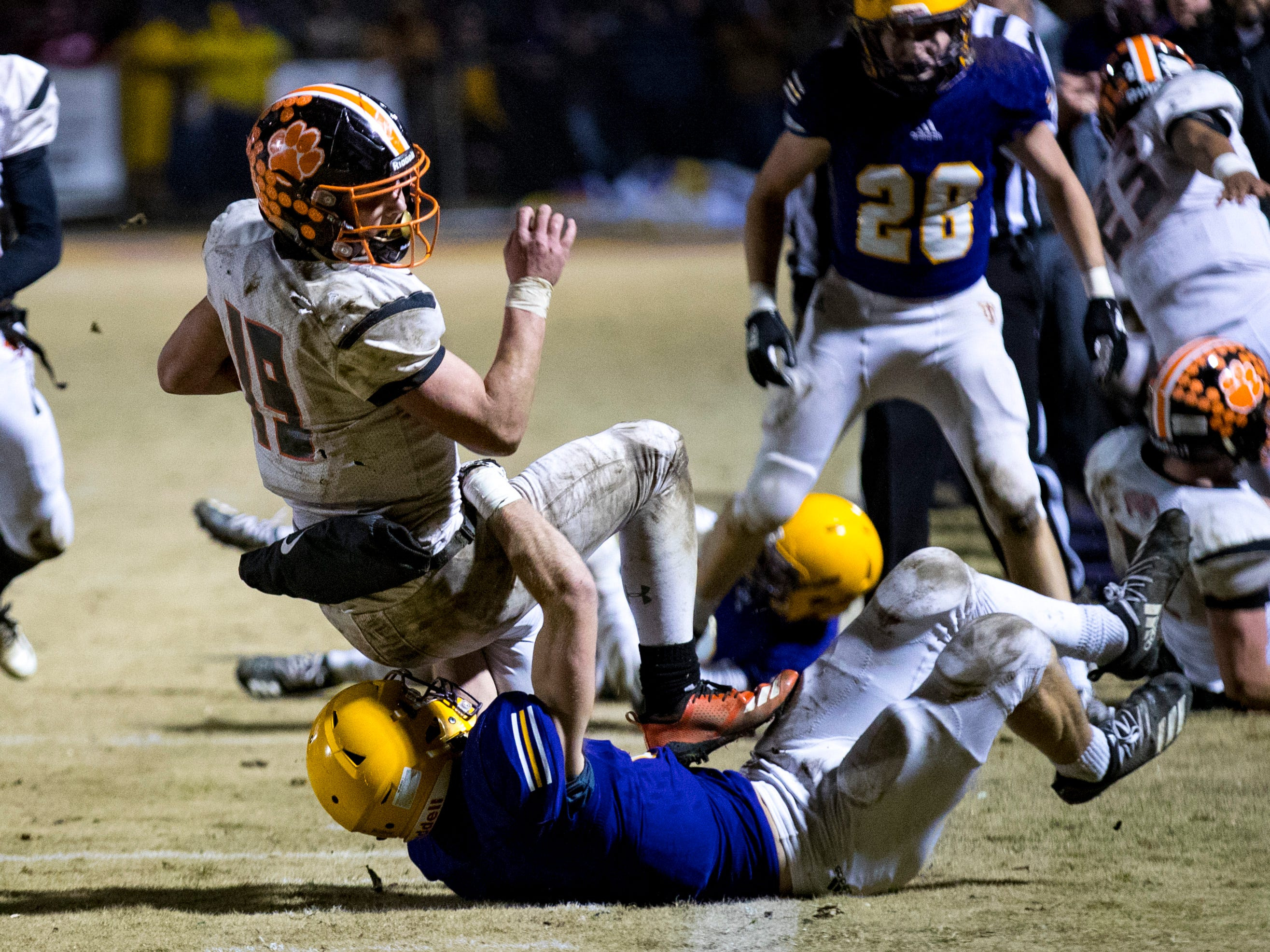 Meigs County's Aaron Swafford (19) is dragged down during Trousdale County's game against Meigs County at Jim Satterfield Stadium in Hartsville on Friday, Nov. 23, 2018.