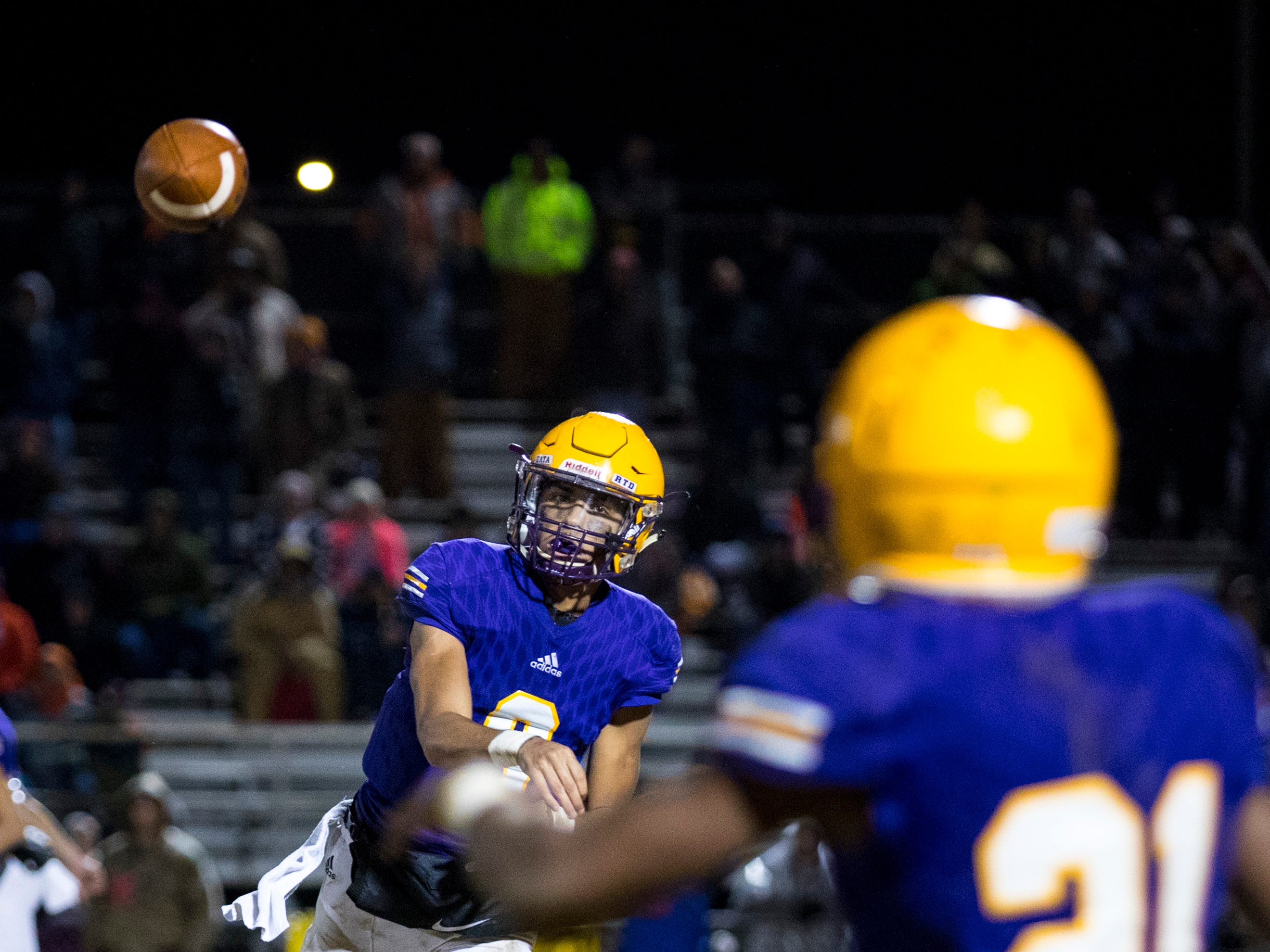 Trousdale County's Keyvont Baines (8) passes to Trousdale County's Dyson Satterfield (21) during Trousdale County's game against Meigs County at Jim Satterfield Stadium in Hartsville on Friday, Nov. 23, 2018.