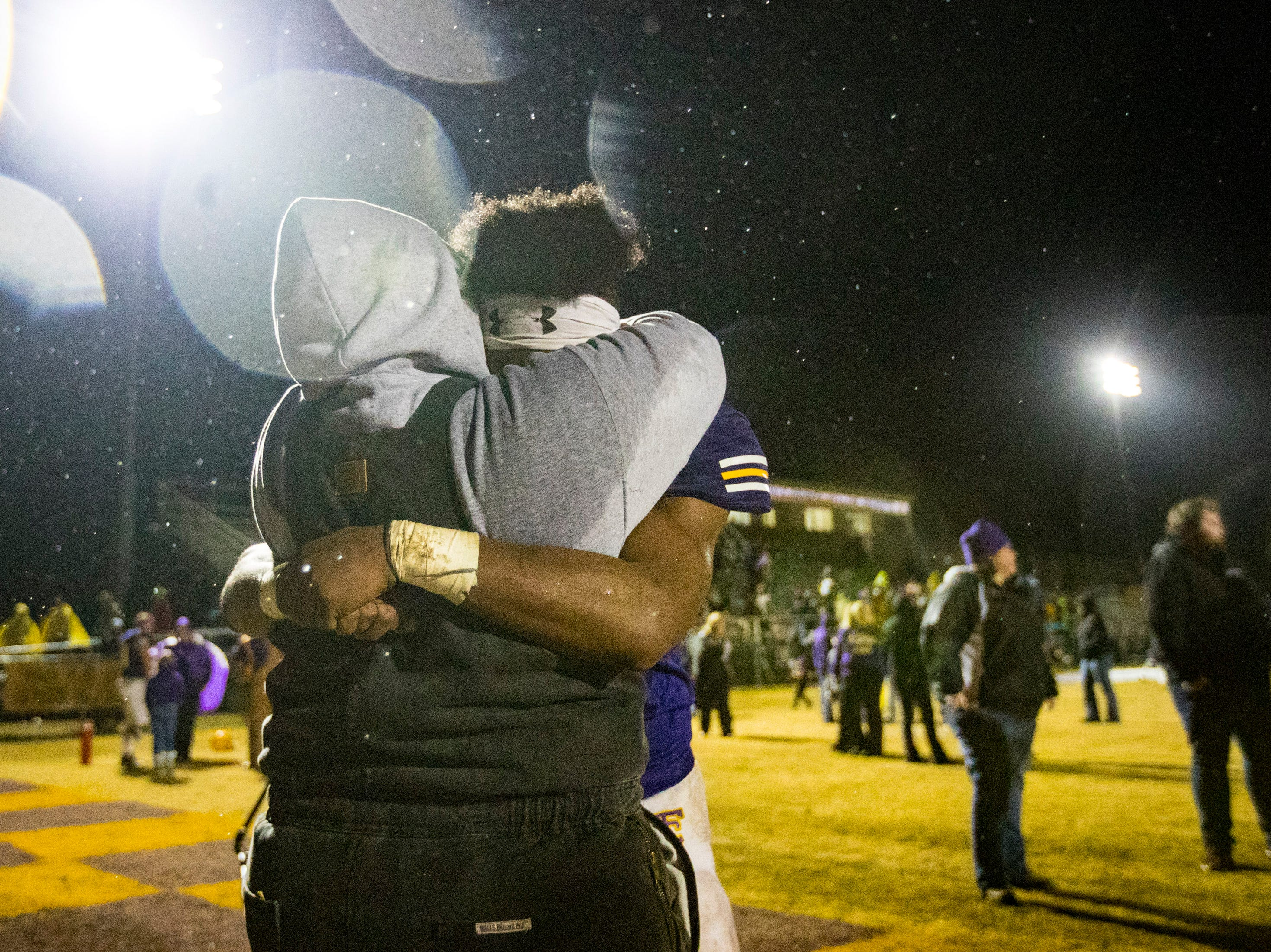 Trousdale County's Dyson Satterfield (21) gets a hug from his mom Kelly Woodmore after Trousdale County's game against Meigs County at Jim Satterfield Stadium in Hartsville on Friday, Nov. 23, 2018.