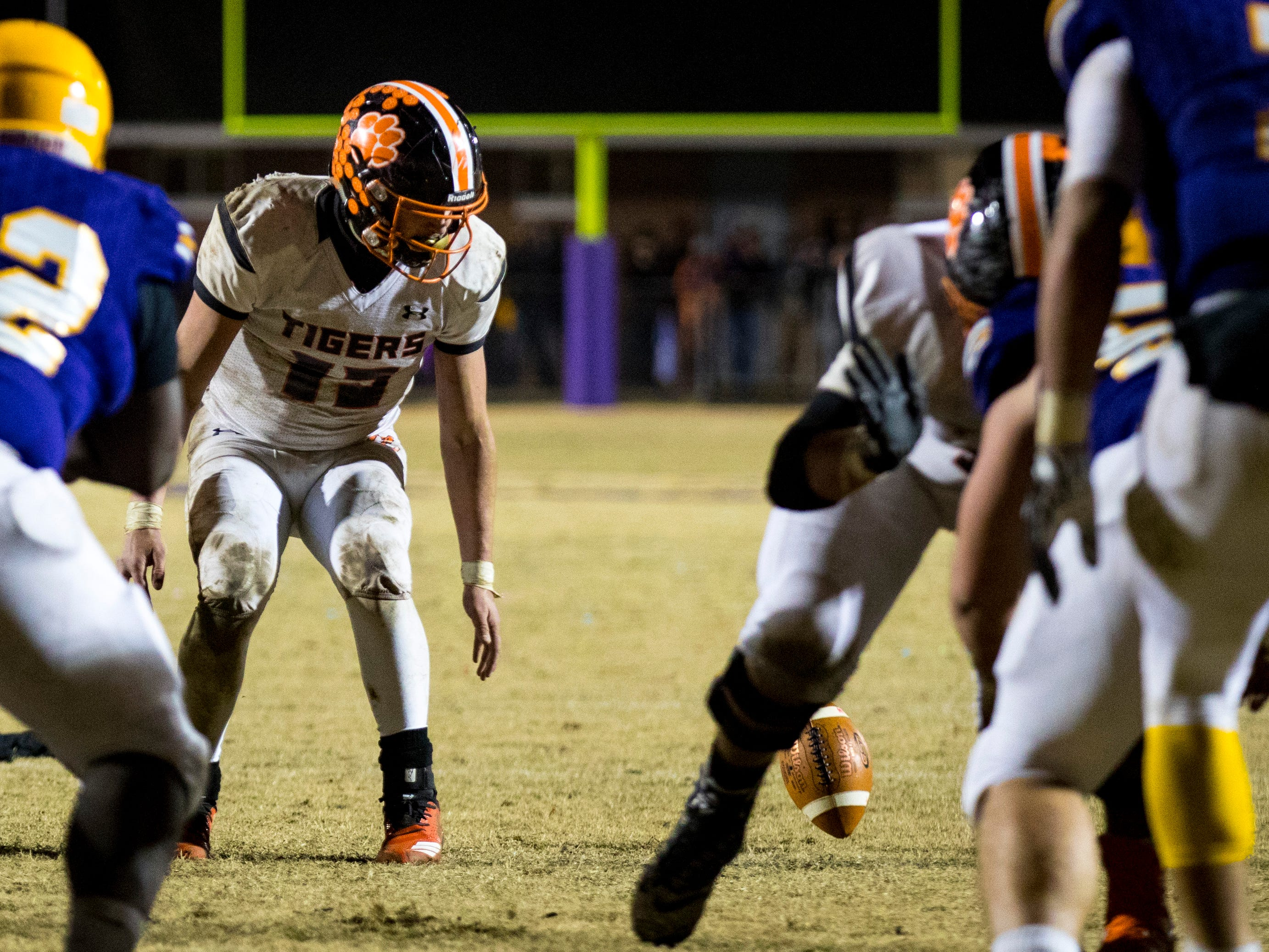 Meigs County's Aaron Swafford (19) looks at a fumbled snap during Trousdale County's game against Meigs County at Jim Satterfield Stadium in Hartsville on Friday, Nov. 23, 2018.