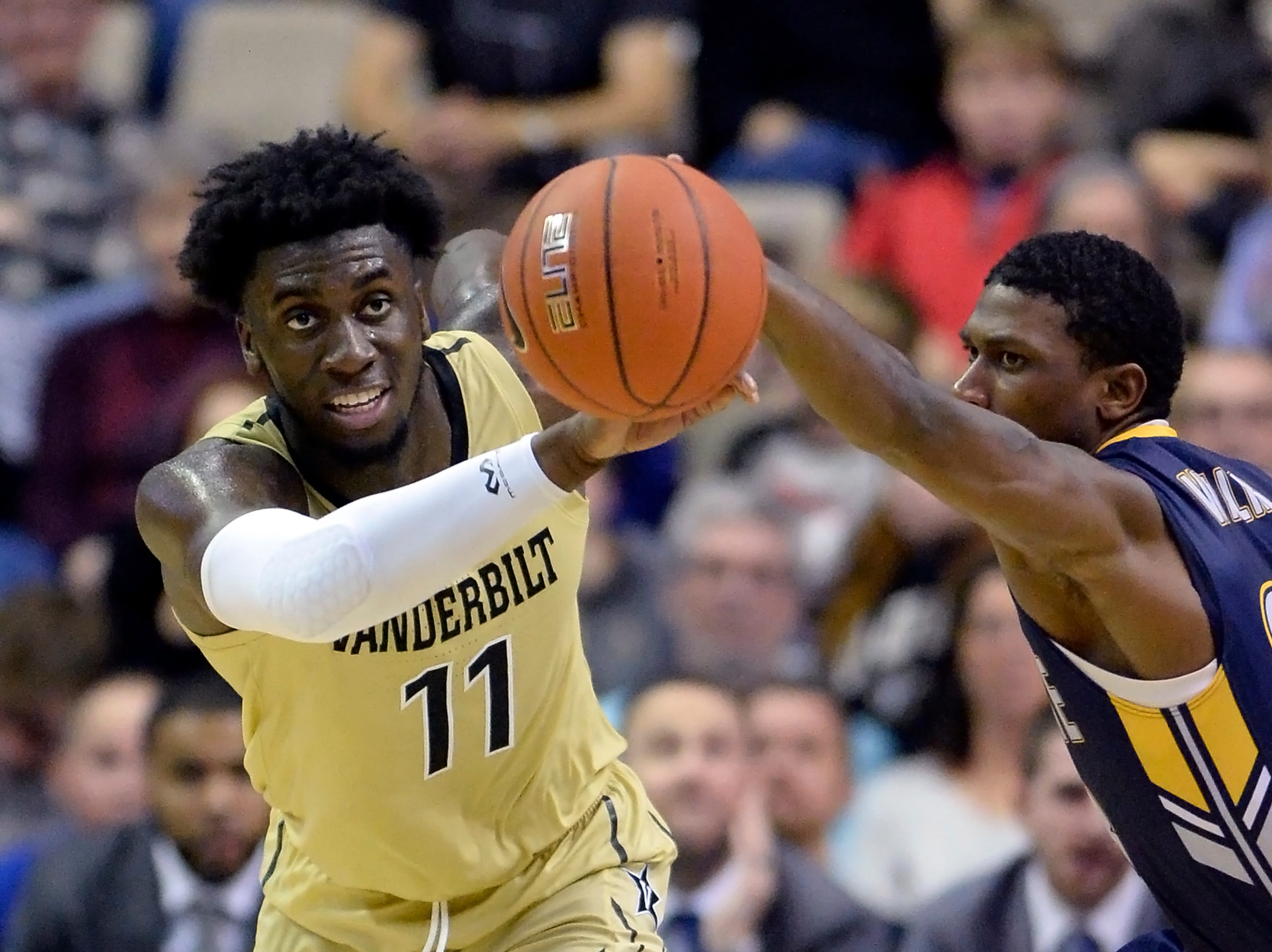Vanderbilt forward Simisola Shittu (11) and Kent State guard Jaylin Walker (23) chase a loose ball during the second half of an NCAA college basketball game Friday, Nov. 23, 2018, in Nashville, Tenn. Kent State won 77-75.