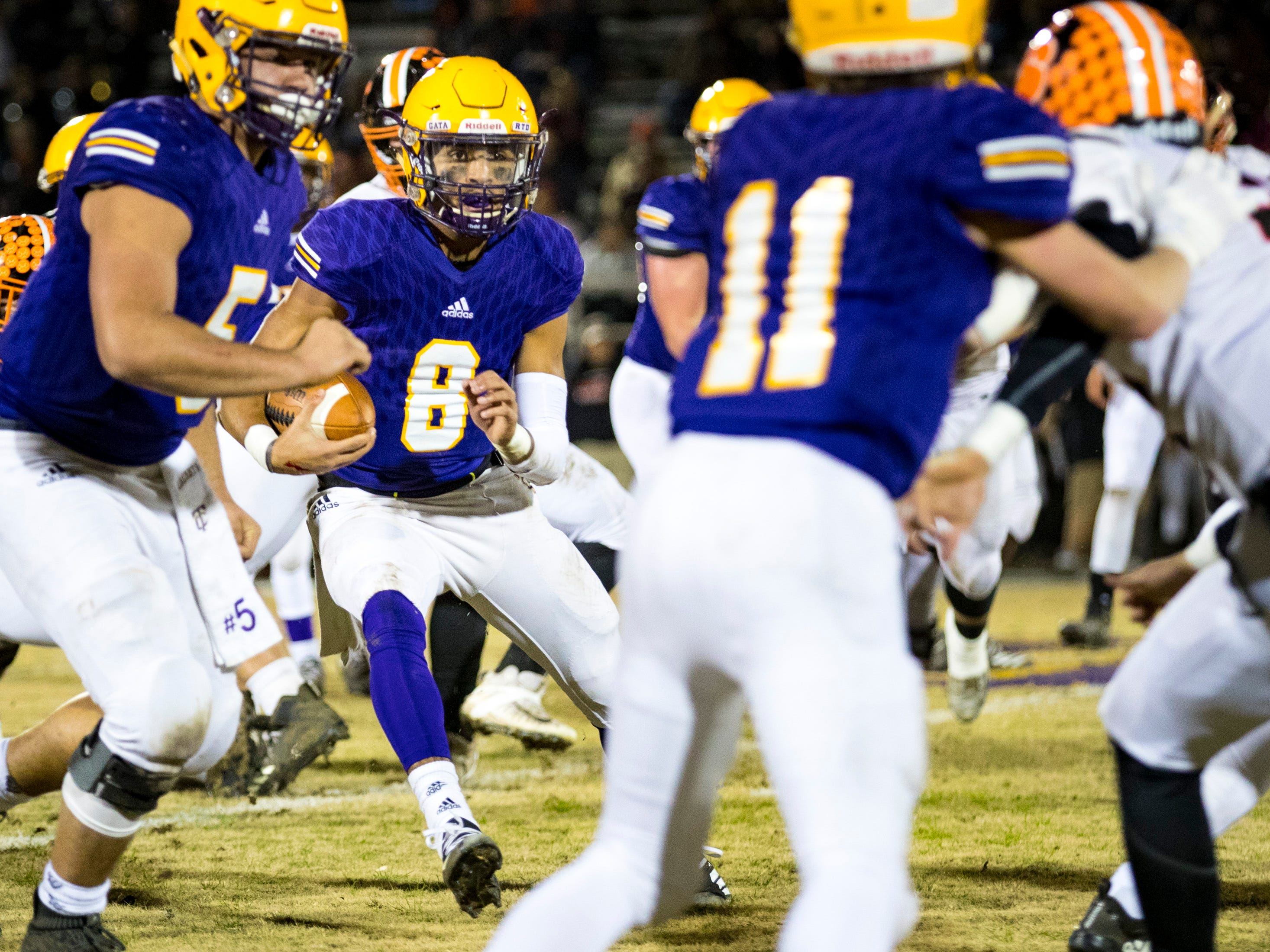 Trousdale County's Keyvont Baines (8) runs through traffic during Trousdale County's game against Meigs County at Jim Satterfield Stadium in Hartsville on Friday, Nov. 23, 2018.
