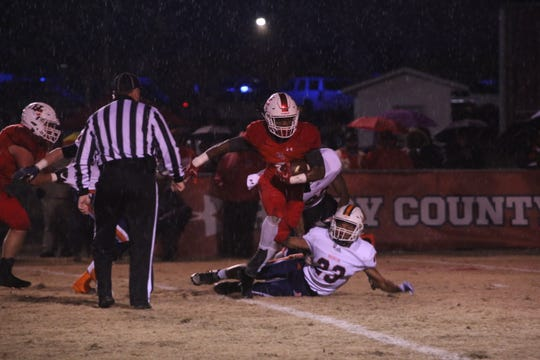 Henry County's Joseph Travis breaks the tackle of a Beech defender during their Class 5A state semifinal game Friday night in Paris.