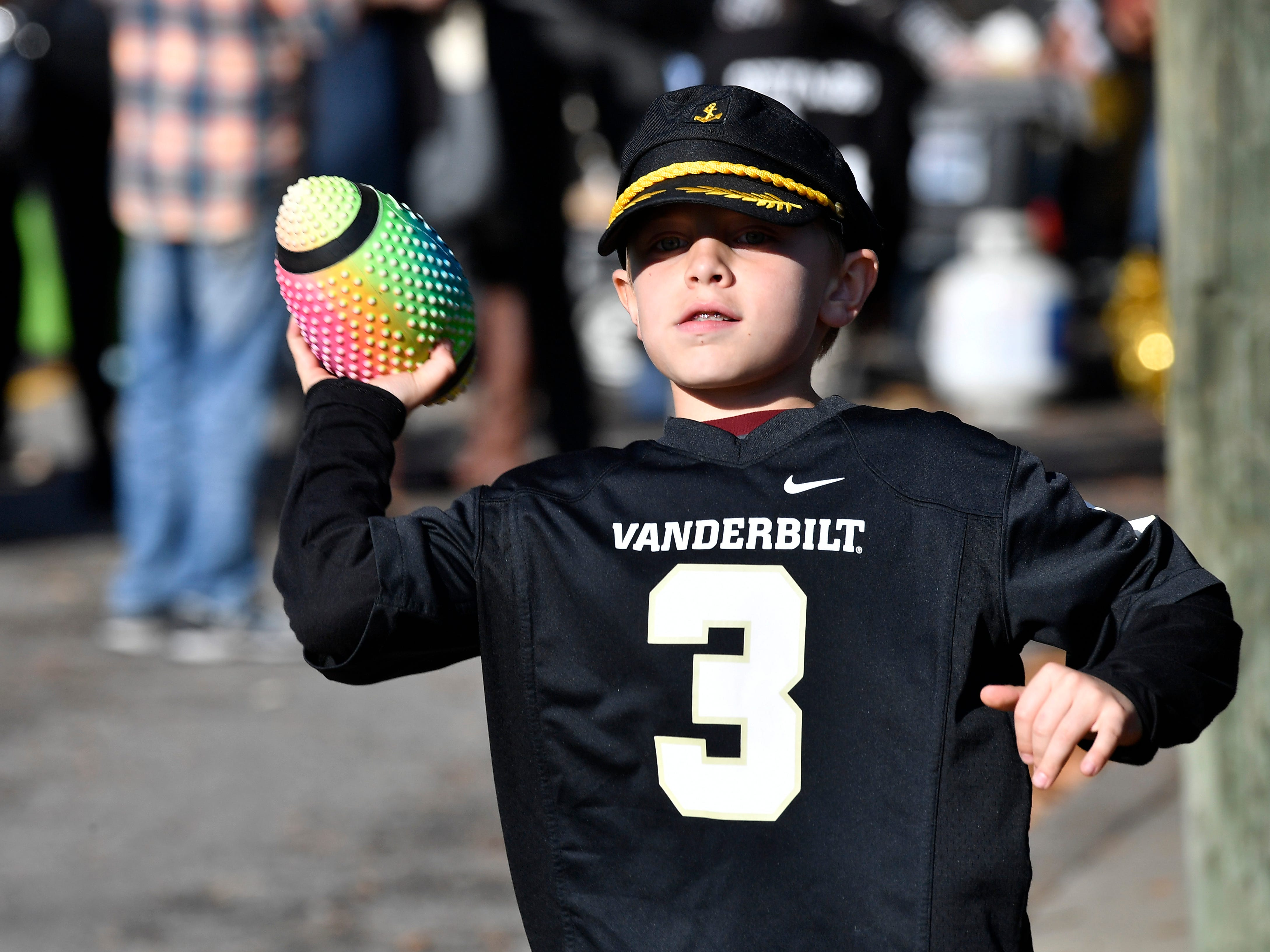 Vandy fan Brady Watts, 8, plays before the game at Vanderbilt Stadium Saturday, Nov. 24, 2018, in Nashville, Tenn.