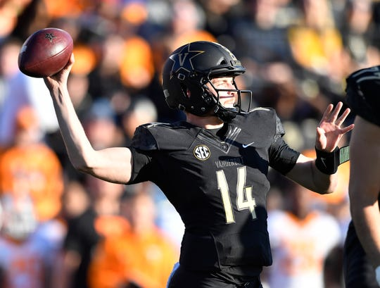 Vanderbilt quarterback Kyle Shurmur (14) passes in the first quarter at Vanderbilt Stadium Saturday, Nov. 24, 2018, in Nashville, Tenn.