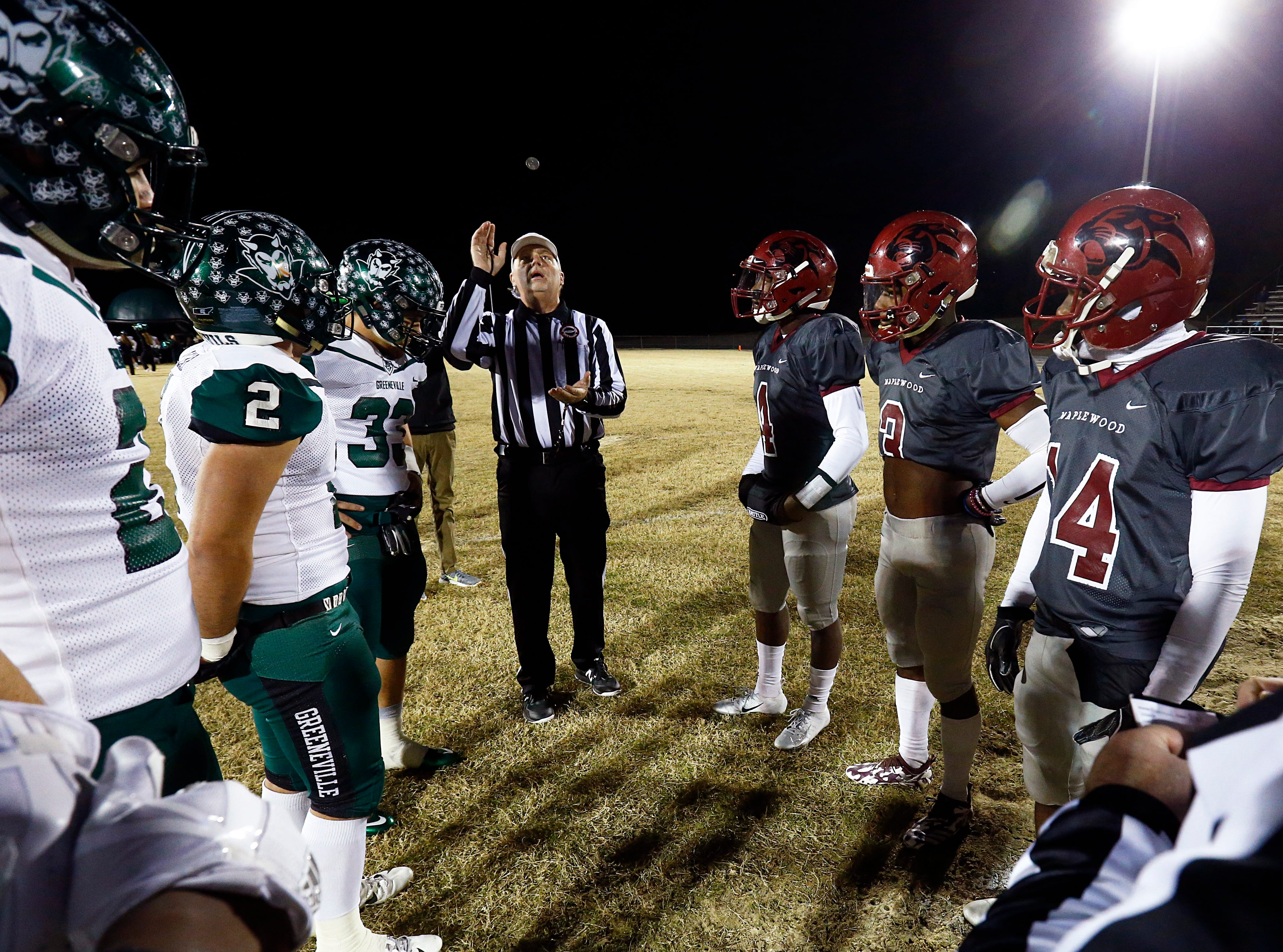 The head official tosses the coin before the game between Greeneville and Maplewood Friday, Nov. 23, 2018, in Nashville, TN.
