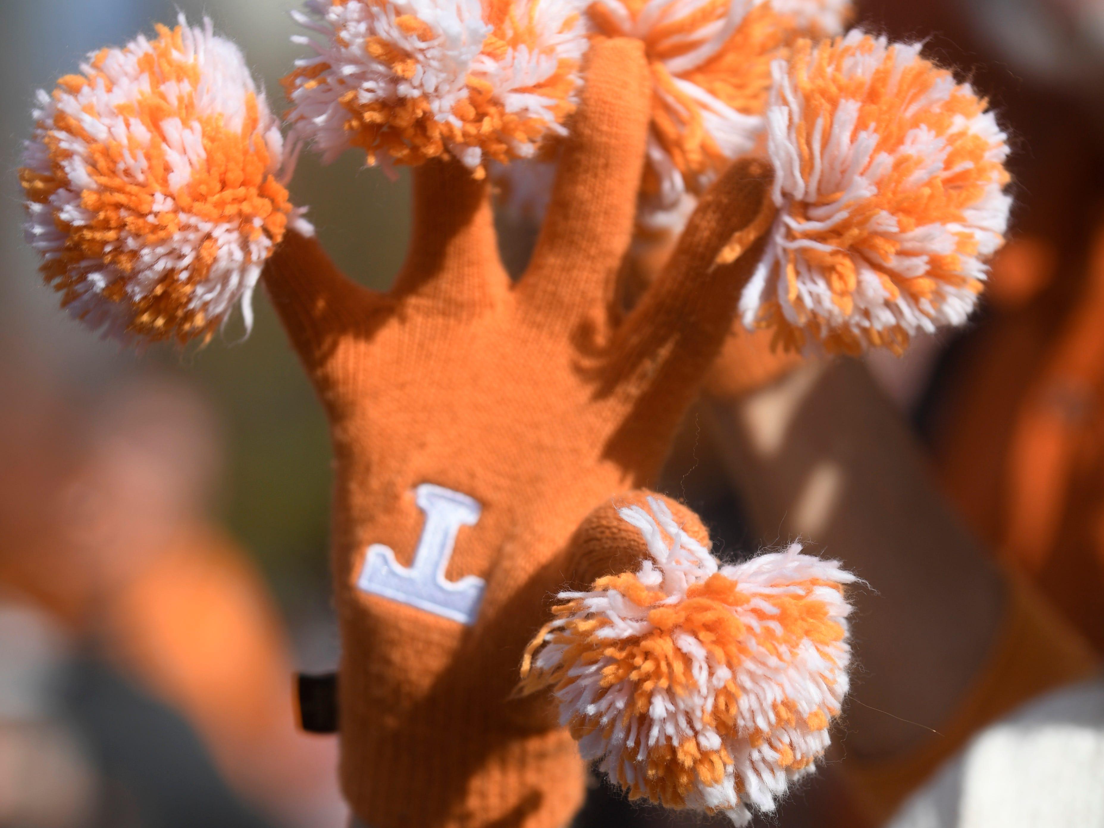 Vols fan Pam Steadmon of Maryville shows off her Tennessee gloves before the game at Vanderbilt Stadium Saturday, Nov. 24, 2018, in Nashville, Tenn.