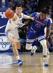 Kentucky's Tyler Herro, left, and Tennessee State's Daniel Cummings chase the ball during the second half of an NCAA college basketball game in Lexington, Ky., Friday, Nov. 23, 2018.
