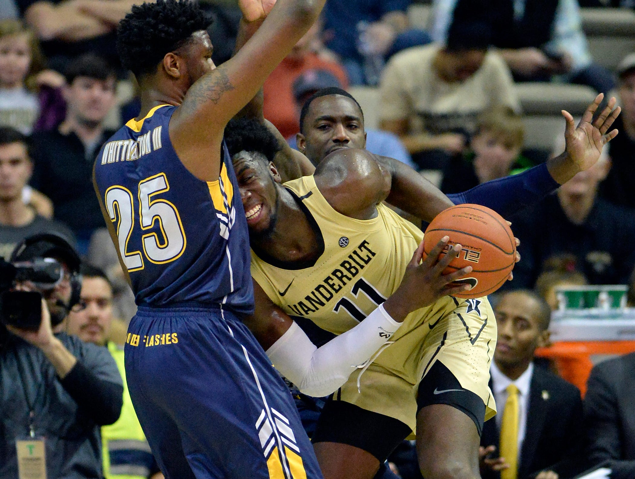 Vanderbilt forward Simisola Shittu (11) tries to drive to the basket against Kent State forward Philip Whittington (25) during the second half of an NCAA college basketball game Friday, Nov. 23, 2018, in Nashville, Tenn. Kent State won 77-75.