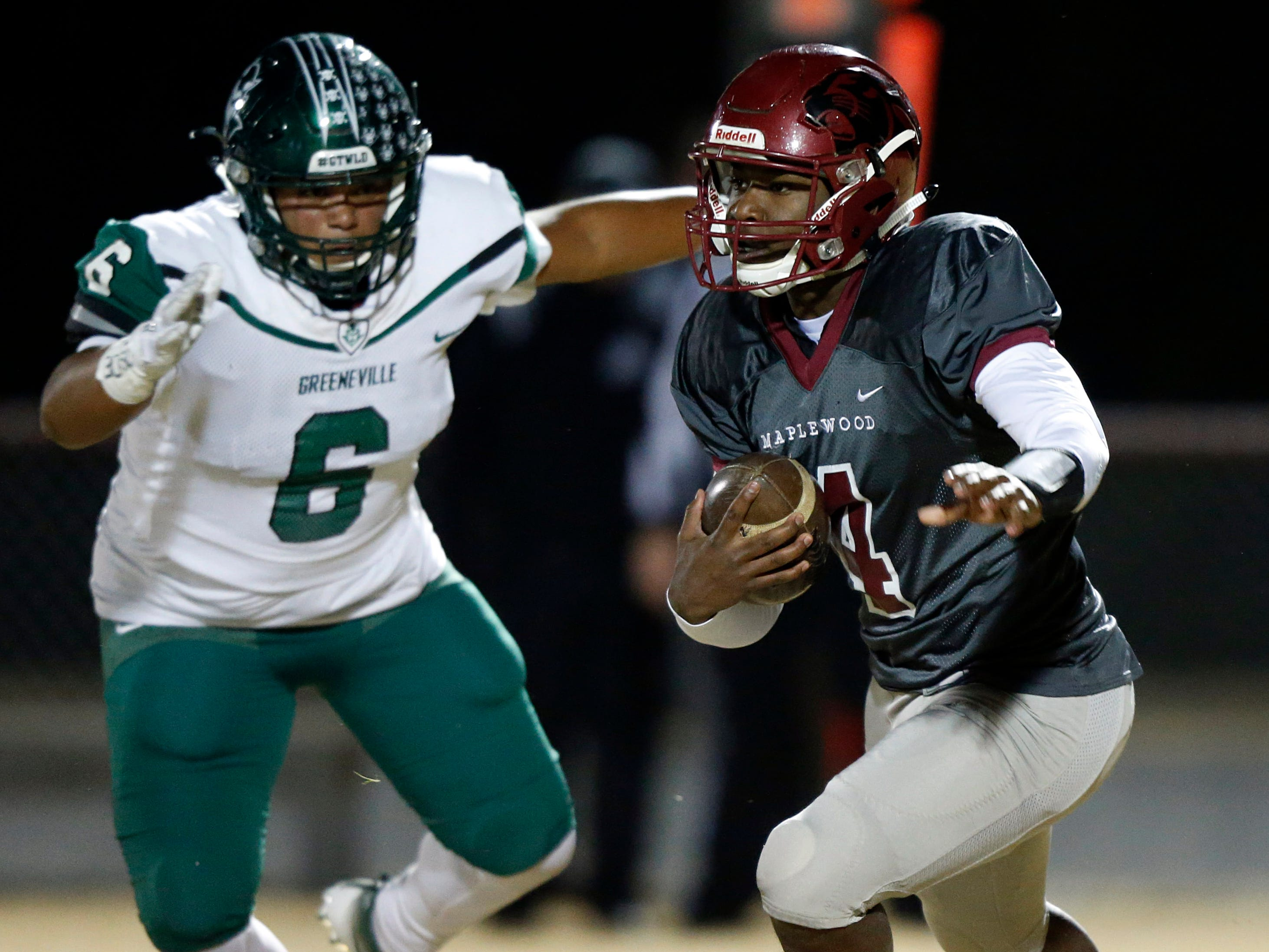 Maplewood's Bobo Hodges (4) runs away from Greeneville's Jacques Gillespie (6) during their game Friday, Nov. 23, 2018, in Nashville, TN.
