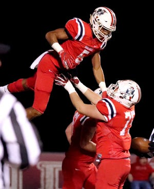 Oakland's Kain Williams (75) tosses Woodi Washington (5) in the air to celebrate a touchdown that was later called back during the game against Maryville at Oakland in Murfreesboro, on Friday, Nov. 23 2018, during the 6A playoffs.