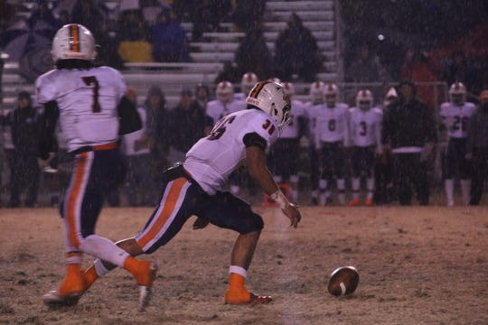 Beech's Aaron Fox (36)  tries to chase down the ball after a fumbled snap during the first quarter against Henry County in their Class 5A state semifinal game Friday in Paris.