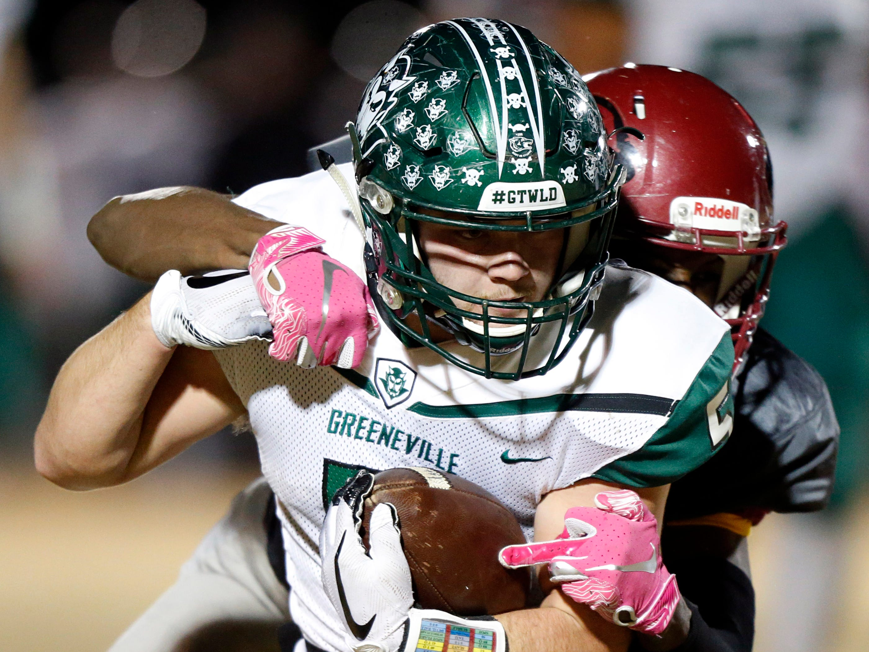 Greeneville's Ty Boyd is tackled from behind by a Maplewood defender during their game Friday, Nov. 23, 2018, in Nashville, TN.