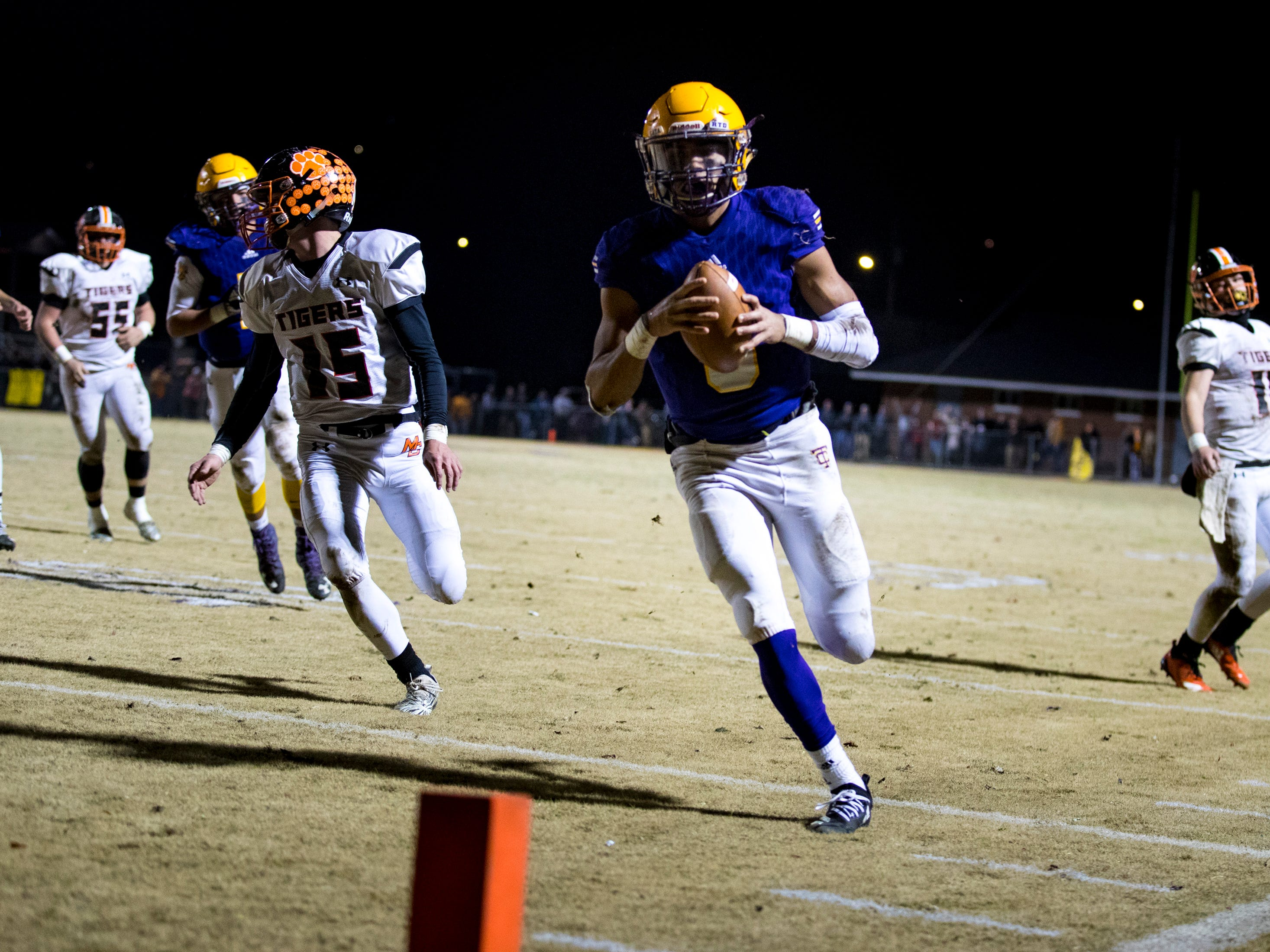 Trousdale County's Keyvont Baines (8) runs for a touchdown during Trousdale County's game against Meigs County at Jim Satterfield Stadium in Hartsville on Friday, Nov. 23, 2018.