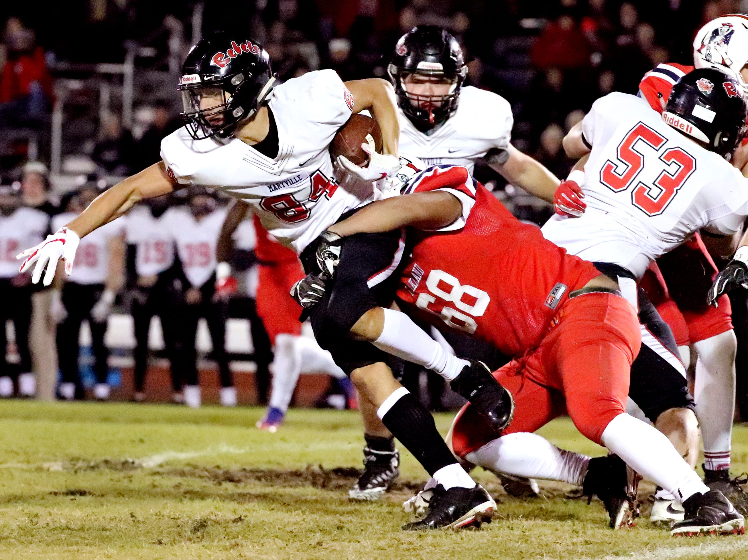 Maryville's Brayden Anderson (84) runs the ball as Oakland's Jaylen Willard (68) tackles him at Oakland in Murfreesboro, on Friday, Aug. 23 2018, during the 6A playoffs.