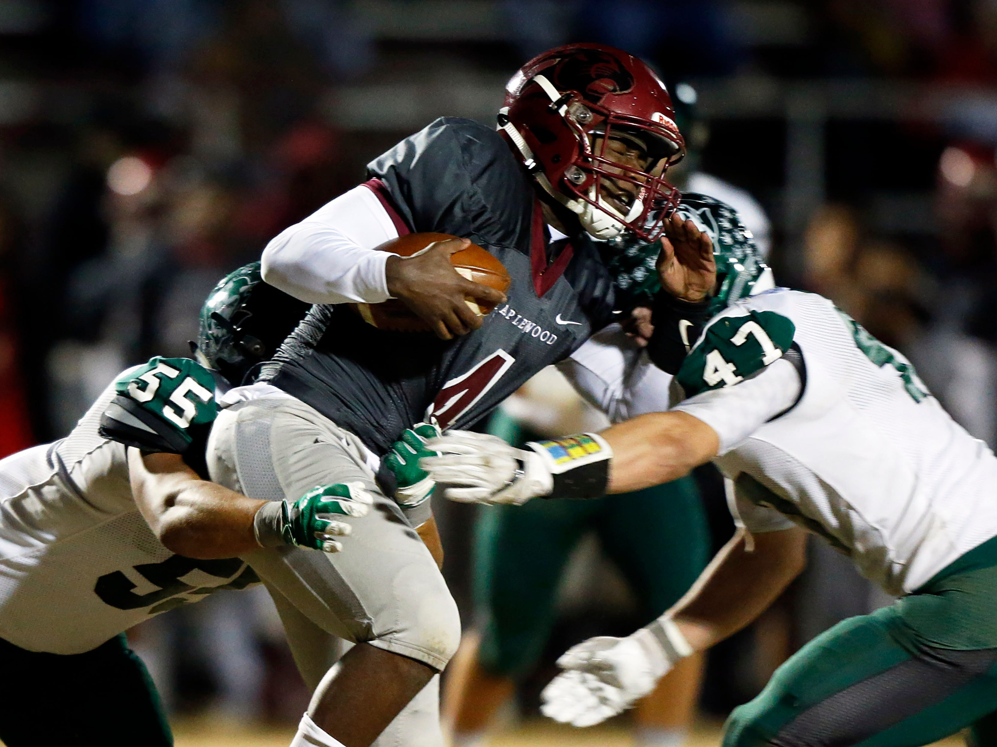 Maplewood's Bobo Hodges is tackled by Greeneville's Ty Youngblood (47) and 	Logan Shipley during their game Friday, Nov. 23, 2018, in Nashville, TN.