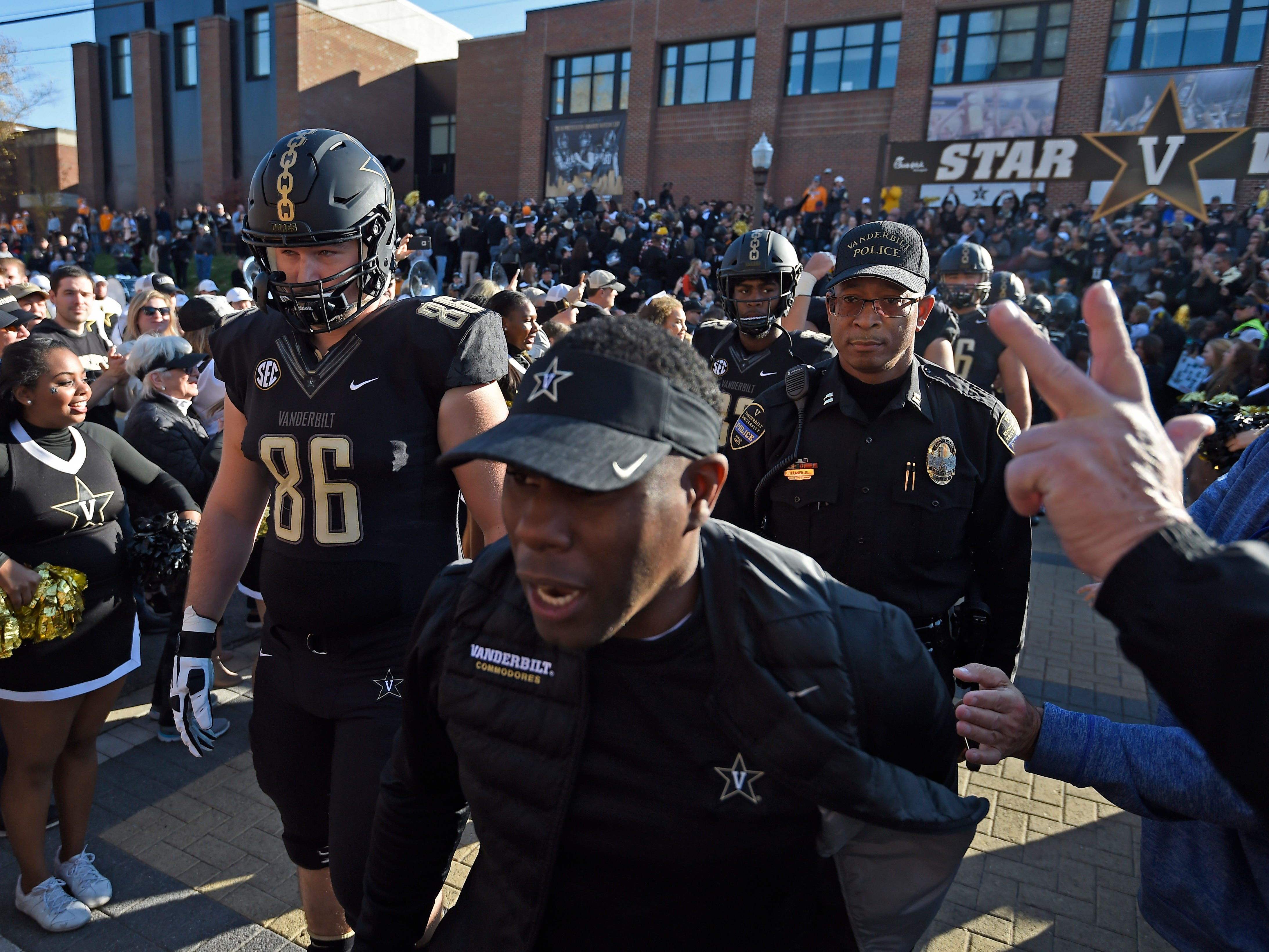 Vanderbilt head coach Derek Mason leads the team during Star Walk at Vanderbilt Stadium Saturday, Nov. 24, 2018, in Nashville, Tenn.