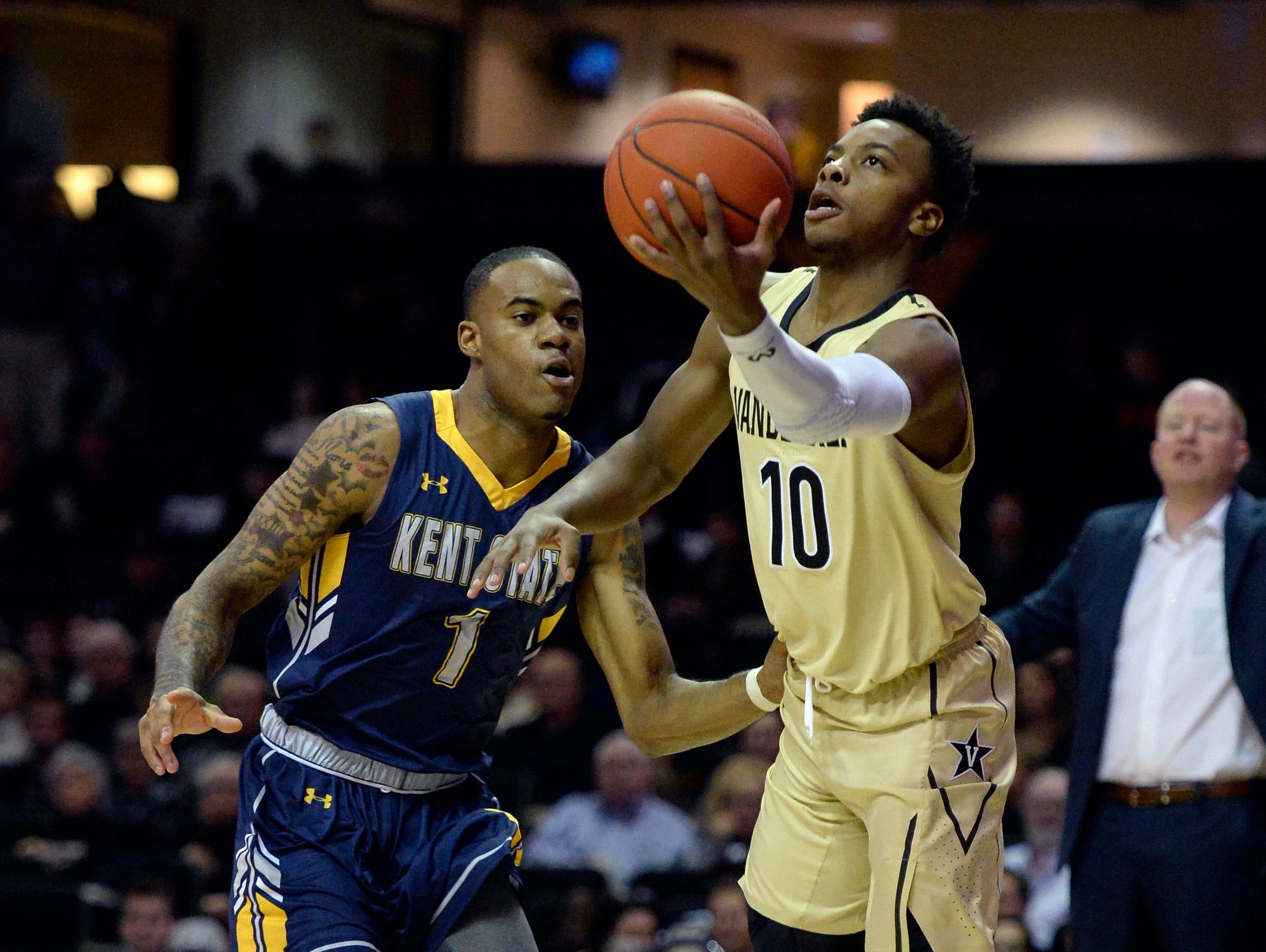 Vanderbilt guard Darius Garland (10) drives past Kent State guard C.J. Williamson (1) during the first half of an NCAA college basketball game Friday, Nov. 23, 2018, in Nashville, Tenn.