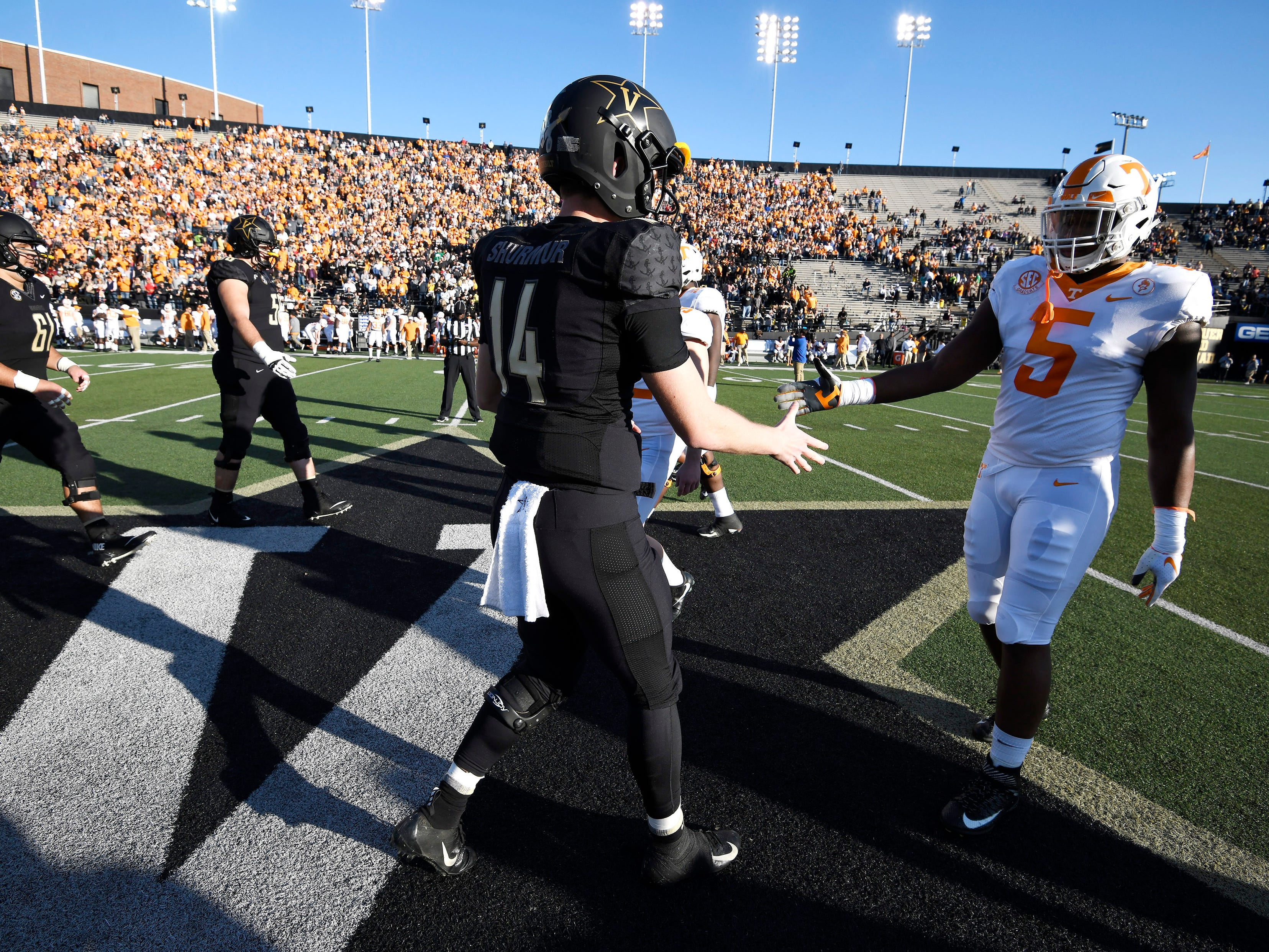 Vanderbilt quarterback Kyle Shurmur (14) and Tennessee defensive lineman Kyle Phillips (5) shake hands before the game at Vanderbilt Stadium Saturday, Nov. 24, 2018, in Nashville, Tenn.