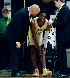 Vanderbilt guard Darius Garland (10) is attended to after being injured against Kent State during the first half of an NCAA college basketball game Friday, Nov. 23, 2018, in Nashville, Tenn.