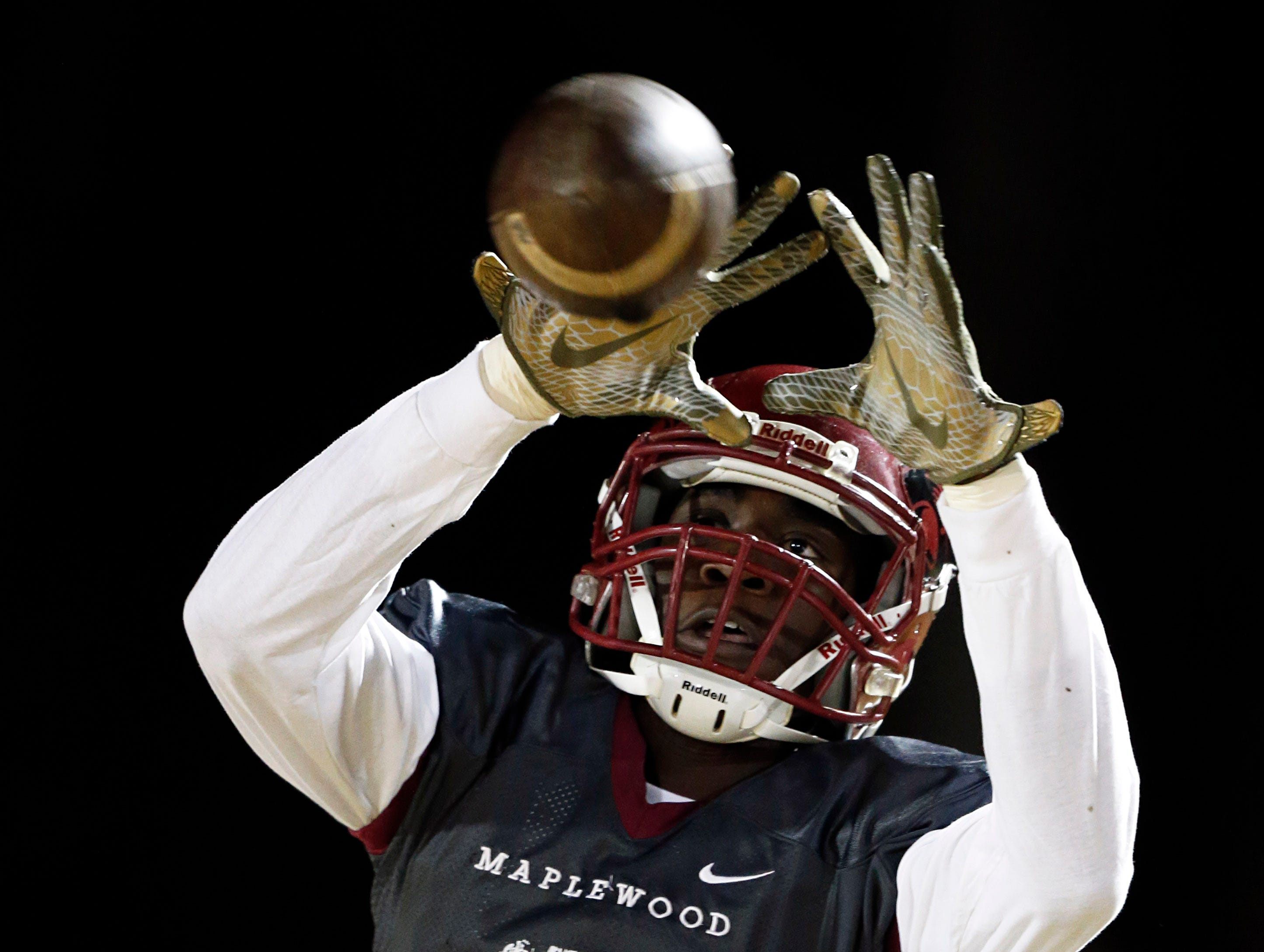 Maplewood's Kendrell Scurry make a catch during warmups before their game against Greeneville Friday, Nov. 23, 2018, in Nashville, TN.